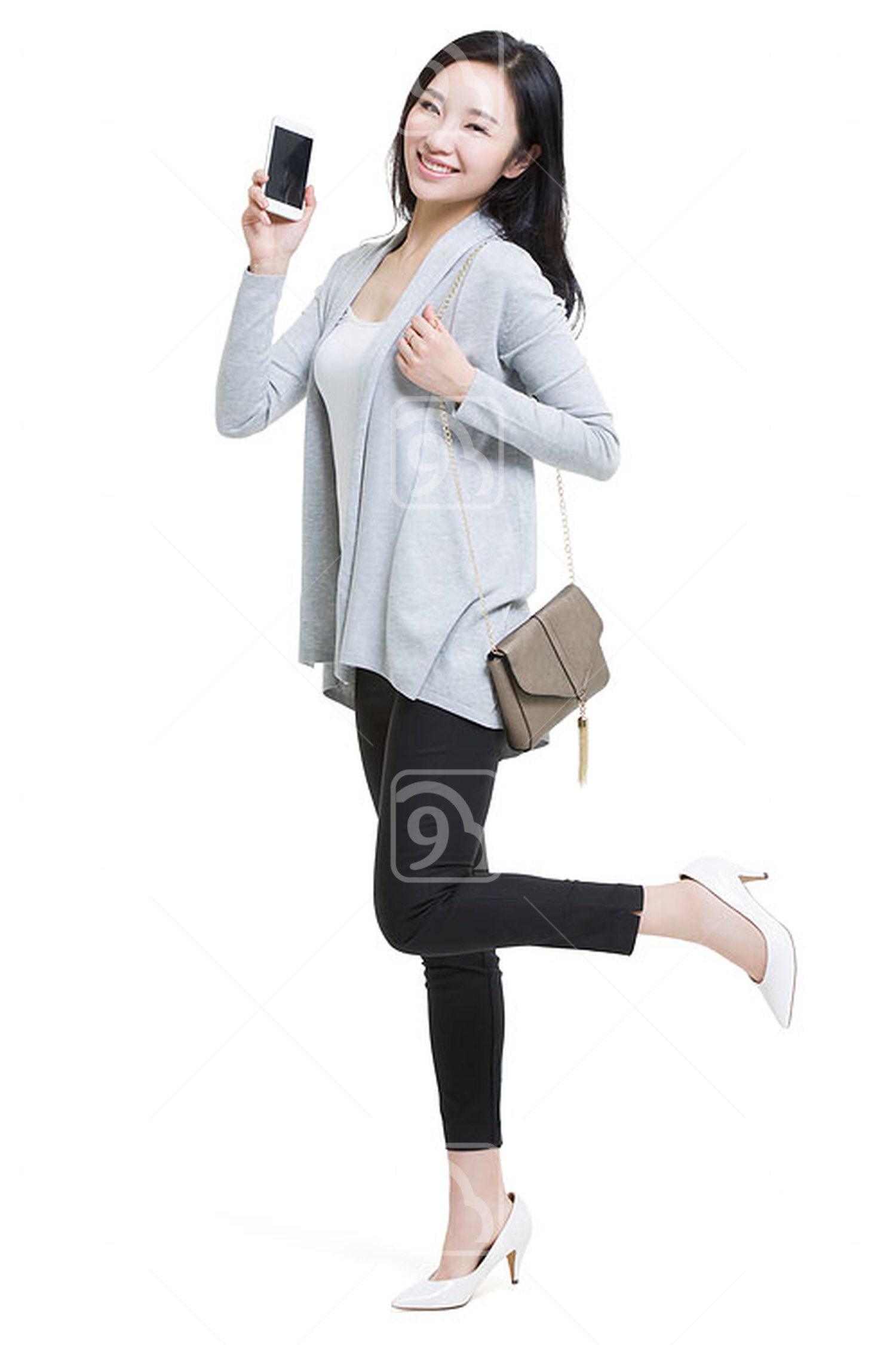 Happy young Chinese woman showing a smart phone