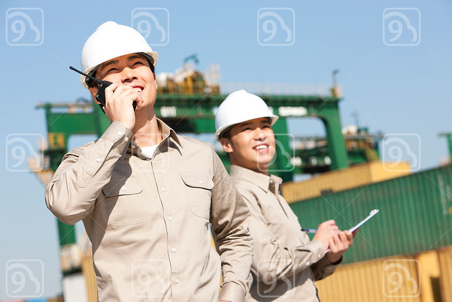 Male Chinese shipping industry workers at work
