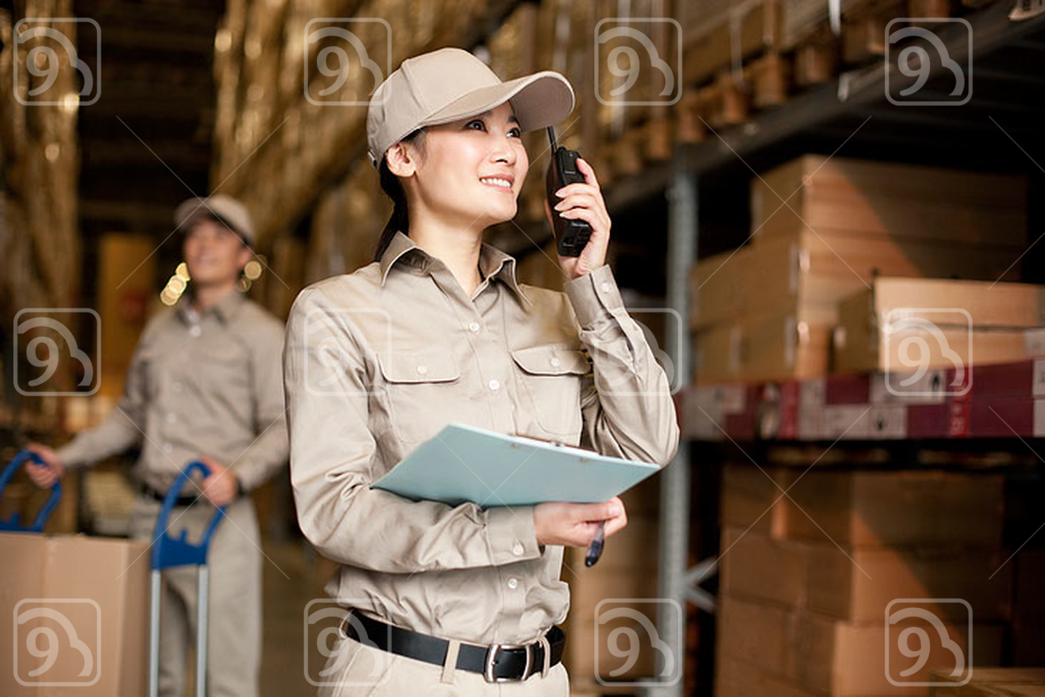 Male and female Chinese workers with walkie-talkie