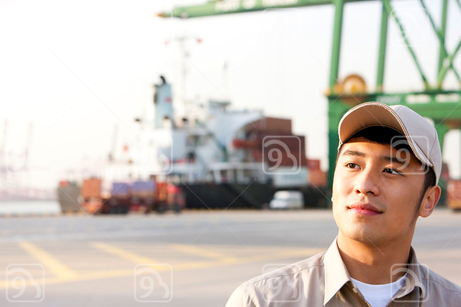 Chinese shipping industry worker contemplating