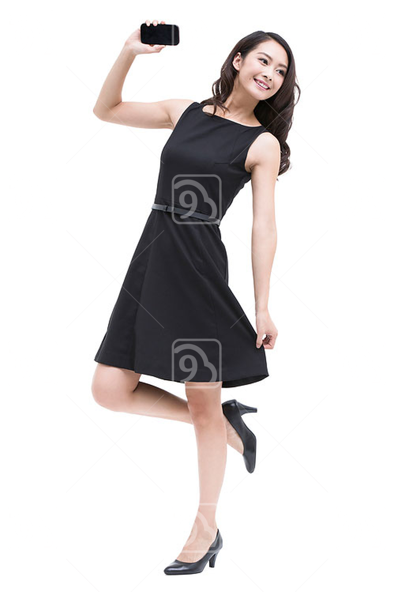 Young Chinese businesswoman with smart phone