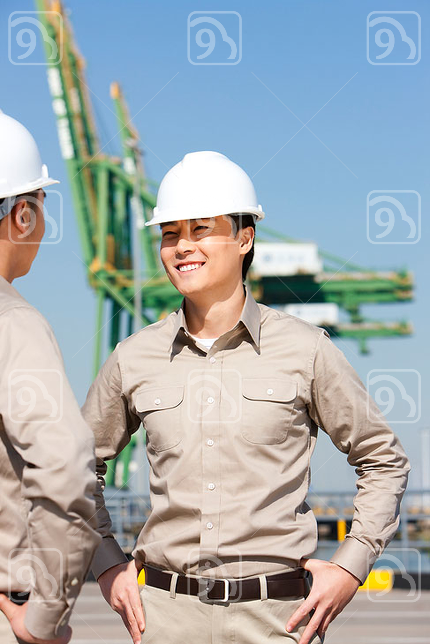 Male Chinese shipping industry workers talking