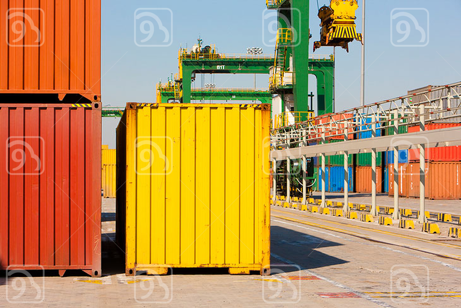 Cargo containers and cranes in shipping dock
