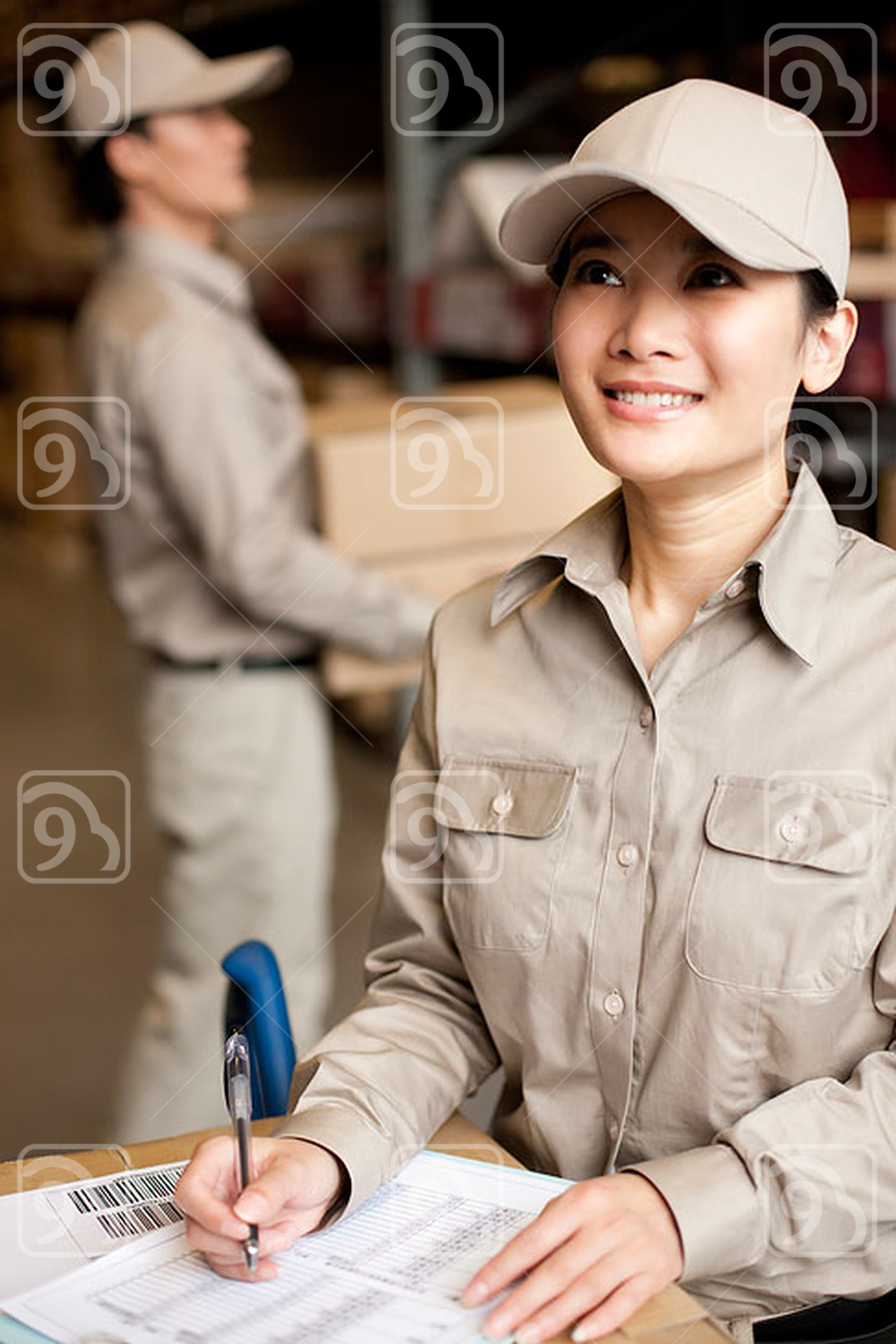Chinese warehouse workers doing inventory