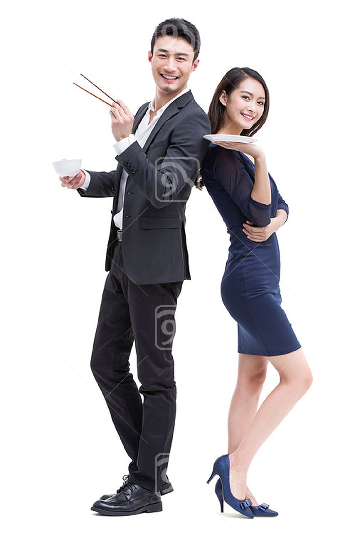 Young Chinese couple with eating utensils