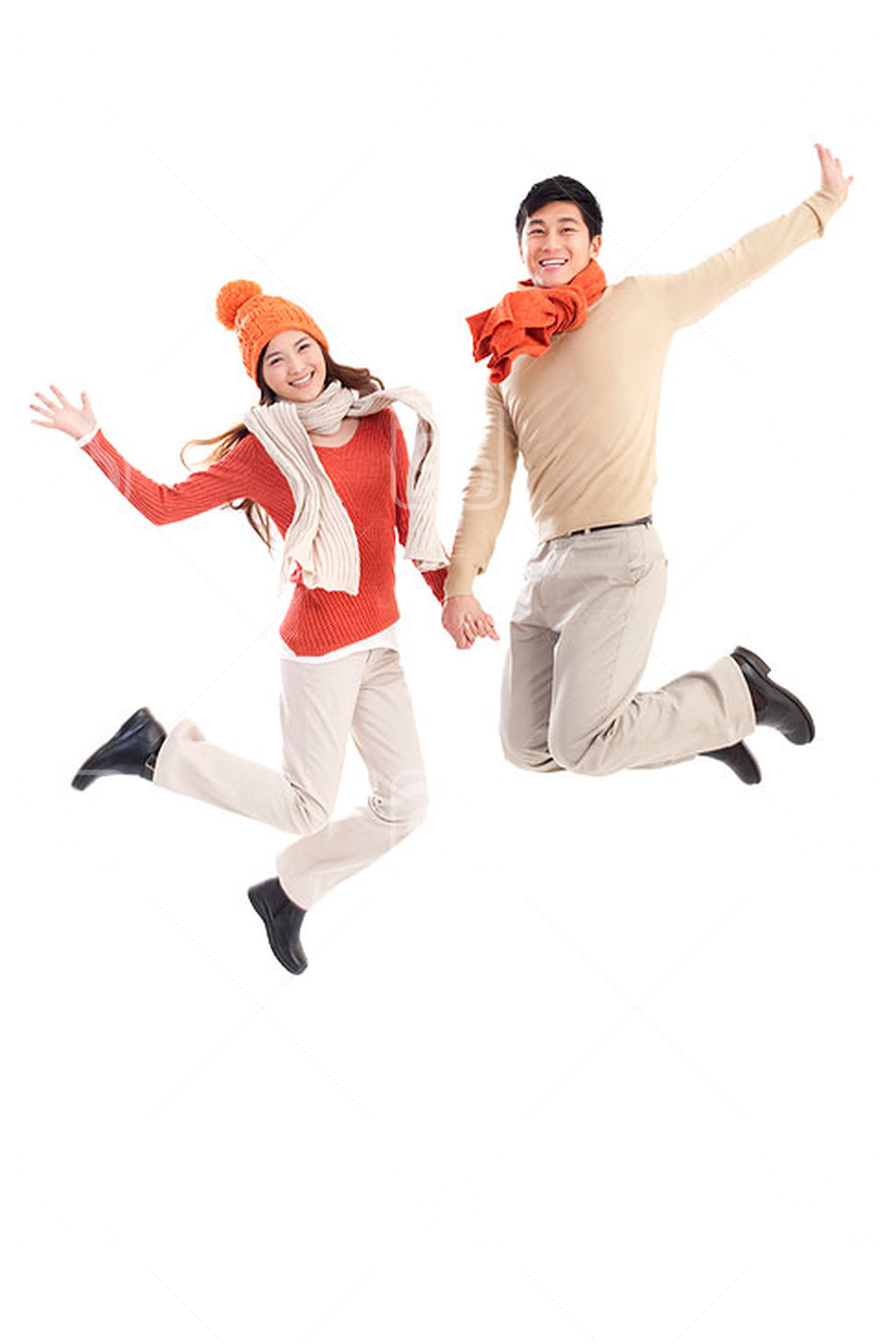 Happy young Chinese couple jumping