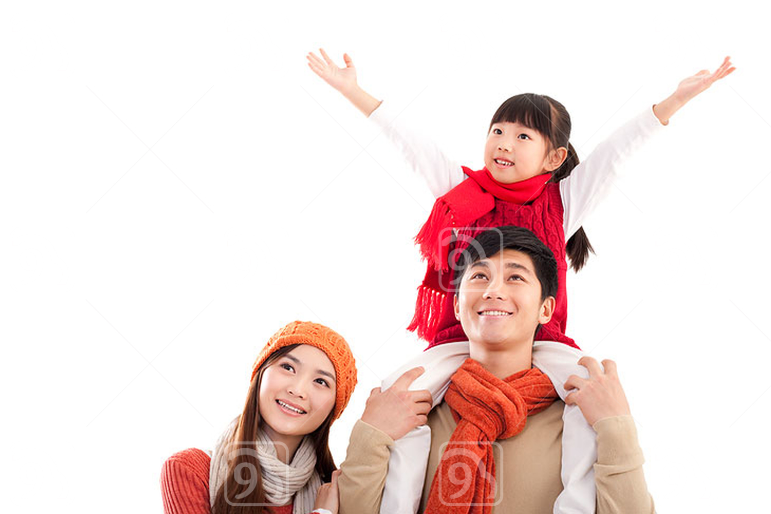 Happy Chinese family looking afar