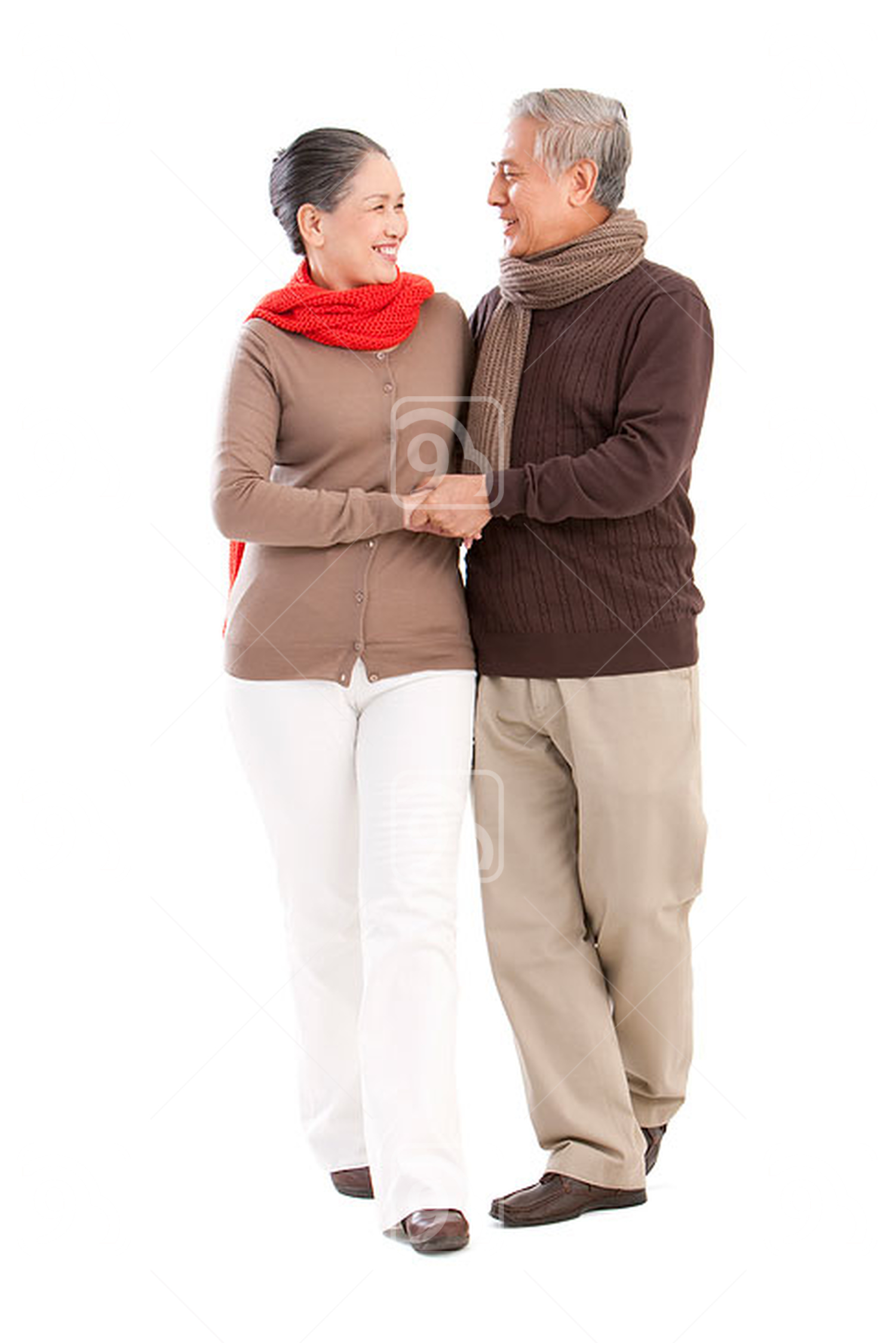 Senior affectionate Chinese couple holding hands