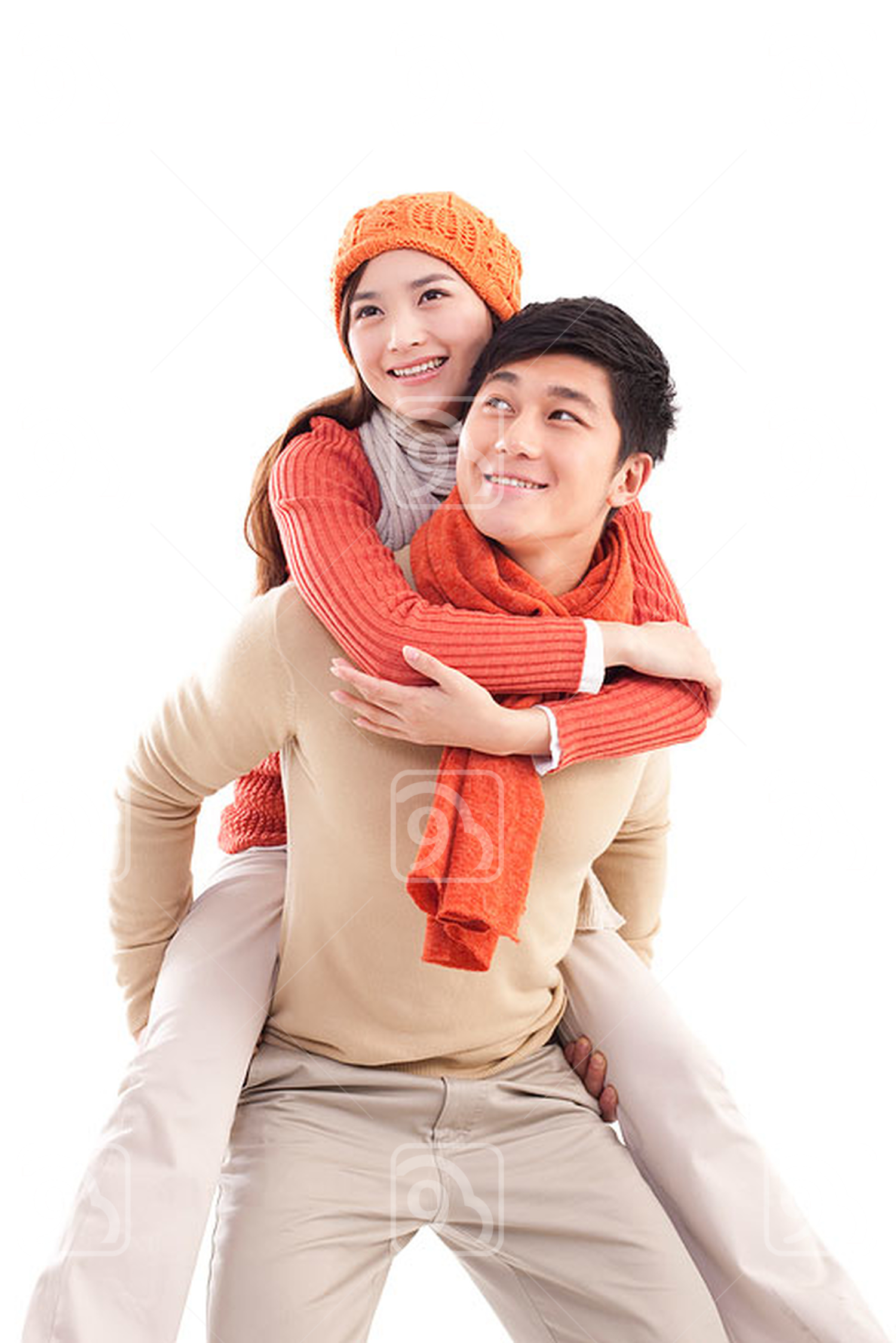 Smiling young Chinese couple doing piggyback