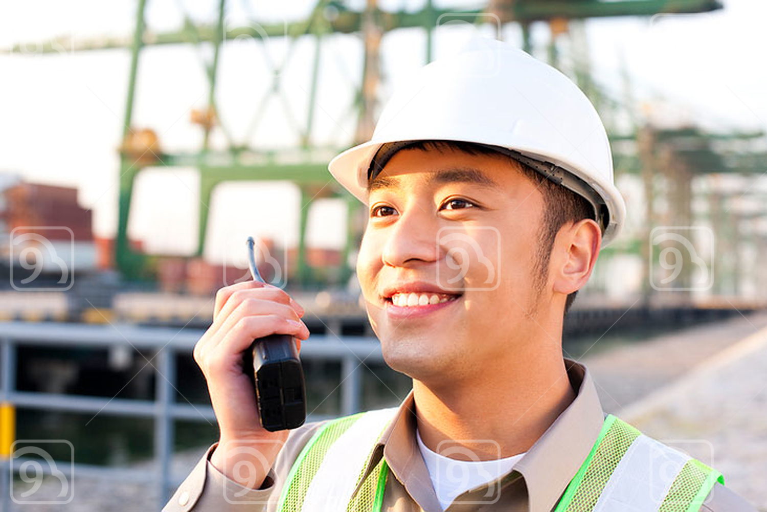Chinese shipping industry worker using a walkie-talkie