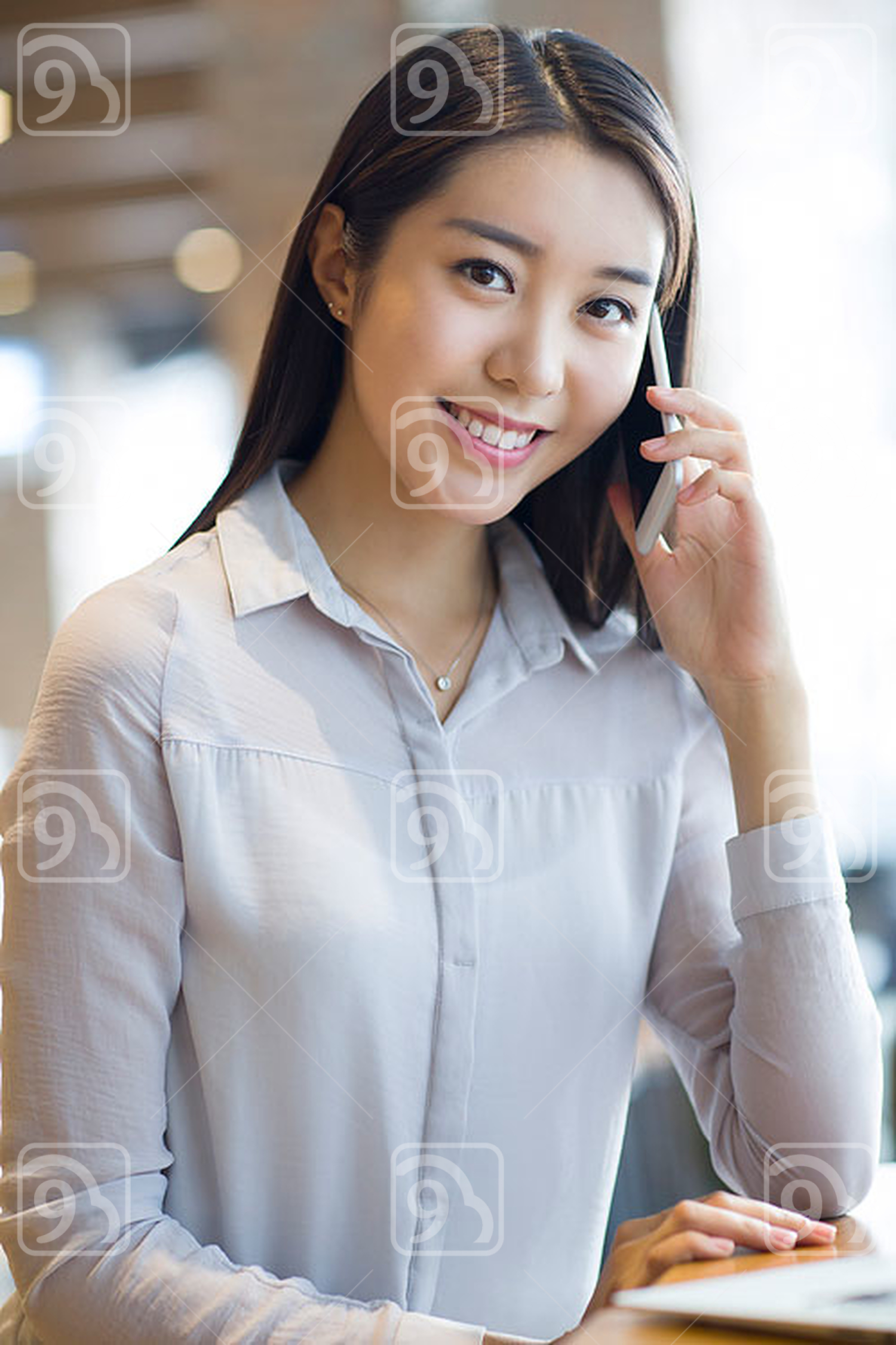 Young Chinese woman talking on the phone