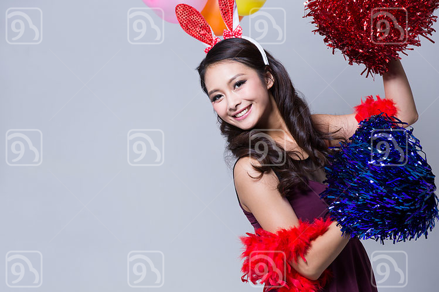 Happy young Chinese woman enjoying a party