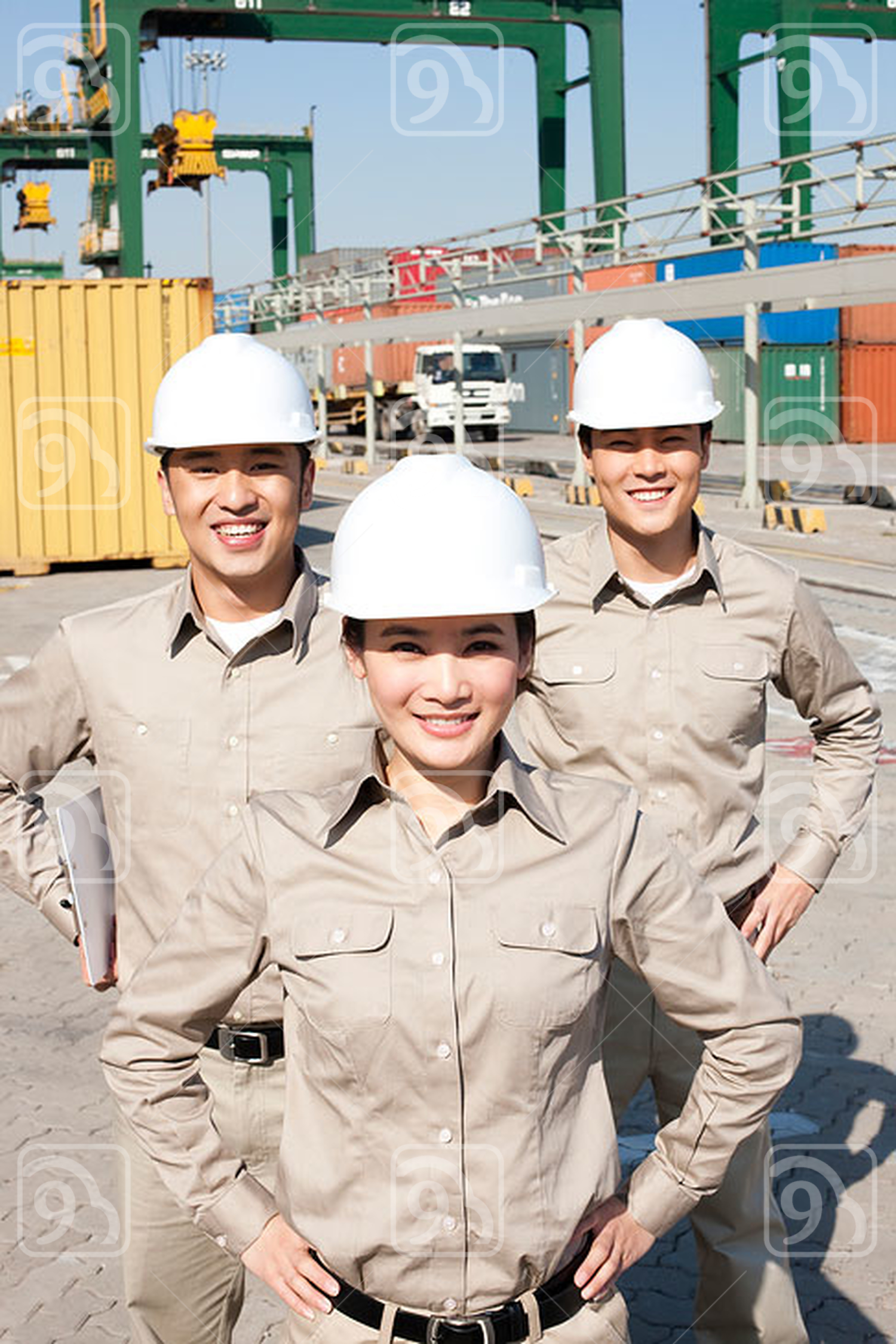 Chinese shipping industry workers with hands on their hips