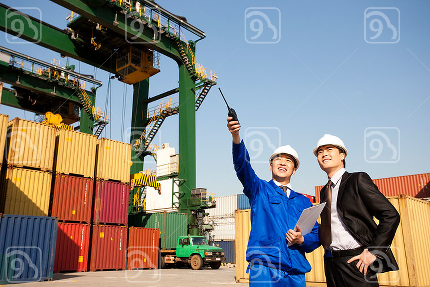 Chinese shipping industry manager pointing and a businessman looking