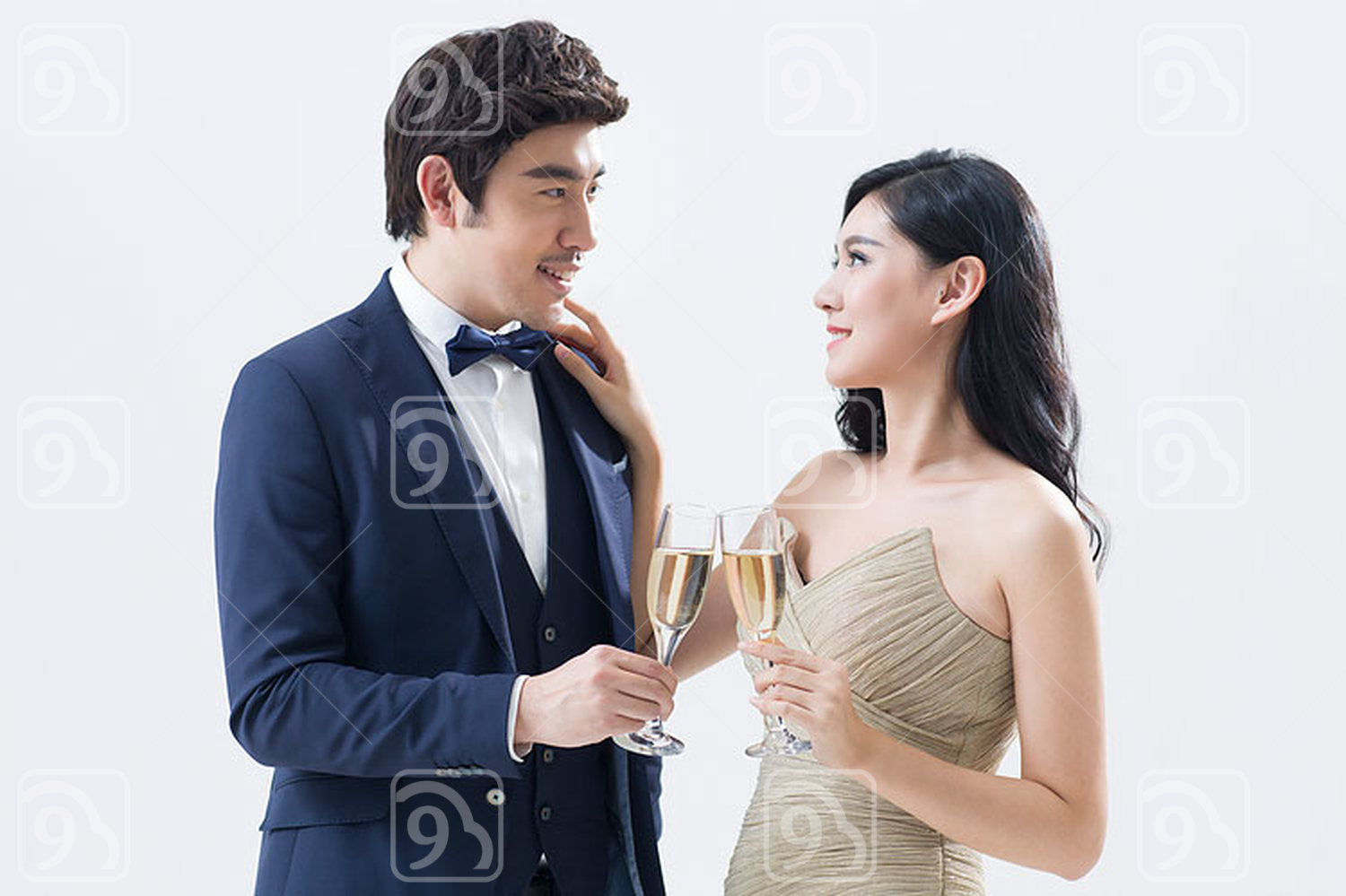 Elegant young Chinese couple drinking champagne