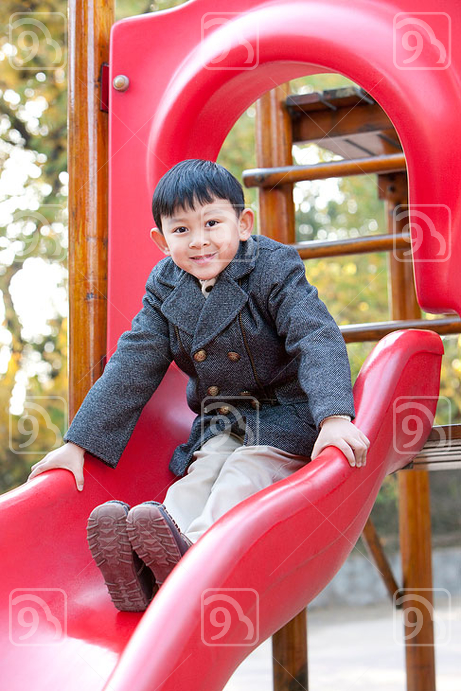Chinese boy on a slide