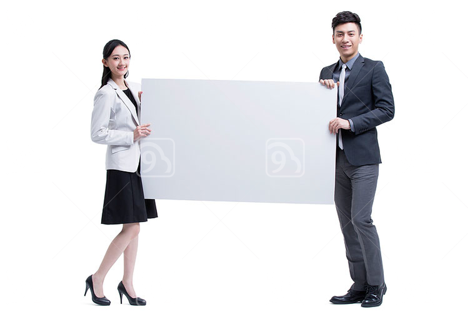 Chinese businessman and businesswoman presenting a whiteboard