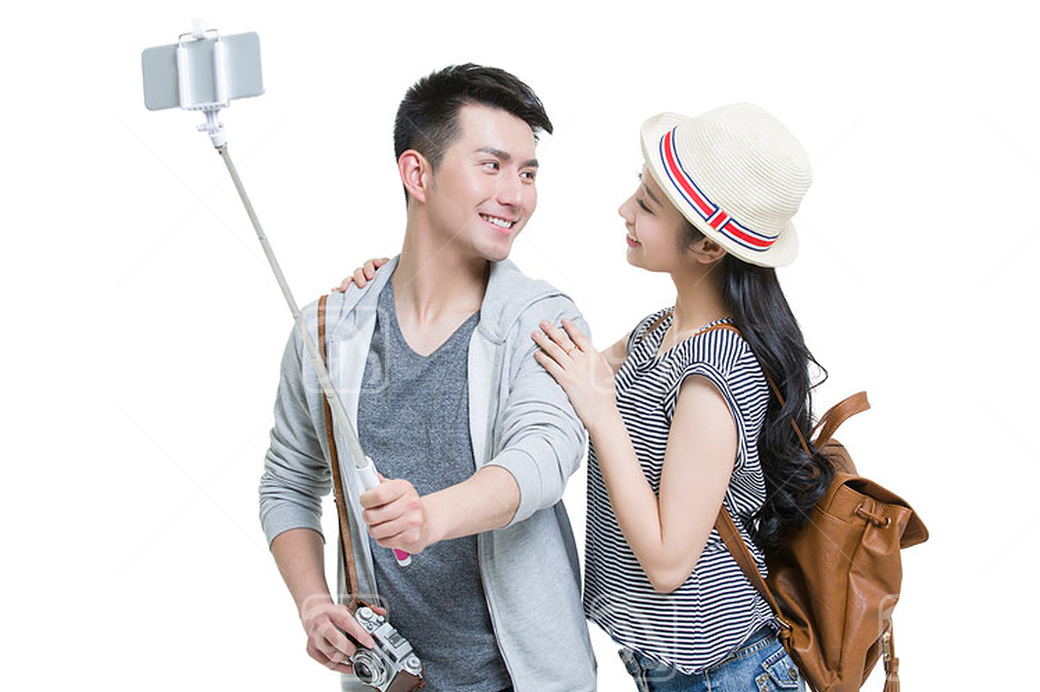 Young Chinese couple taking self portrait with a smart phone