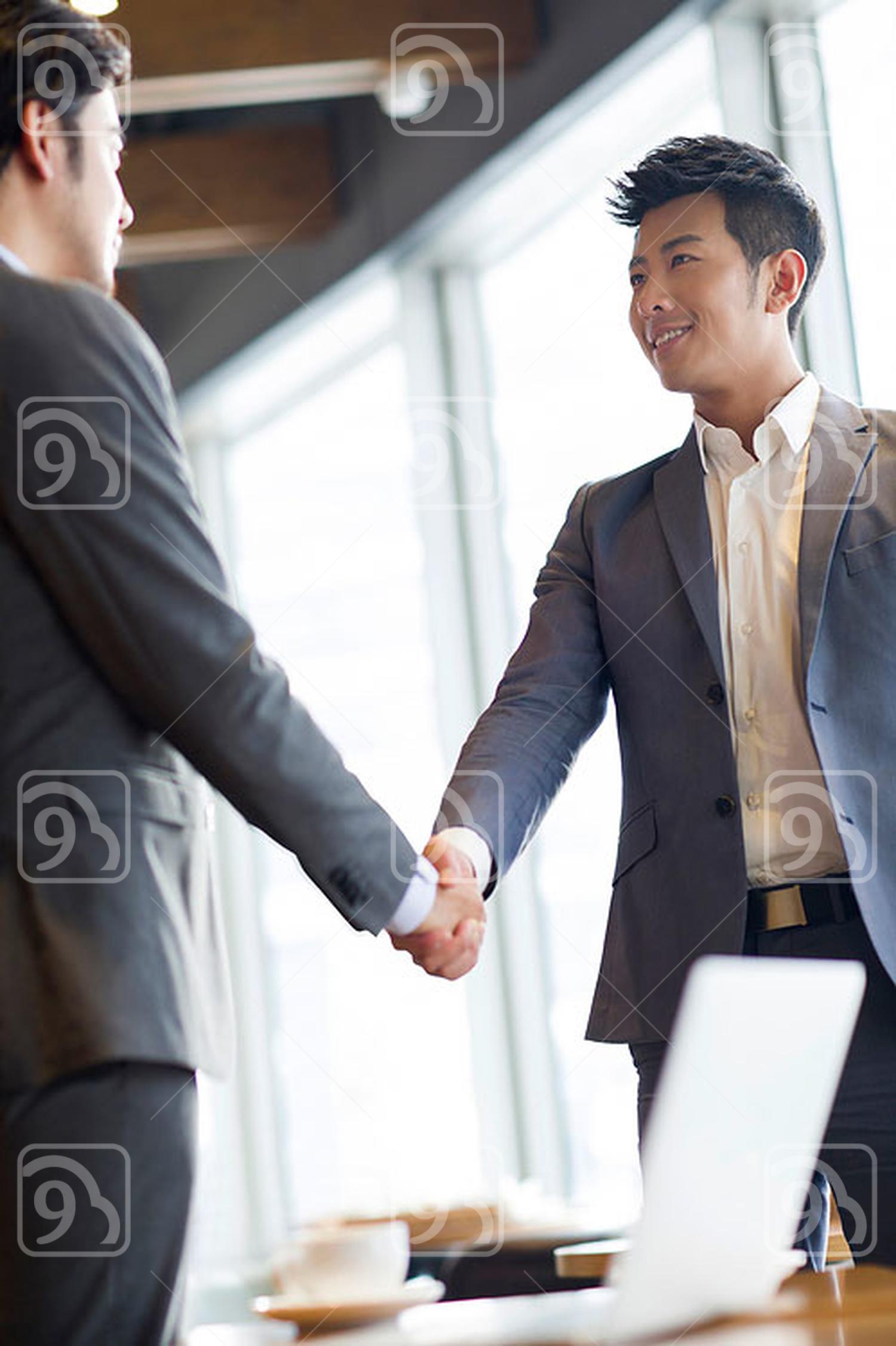 Chinese businessmen shaking hands