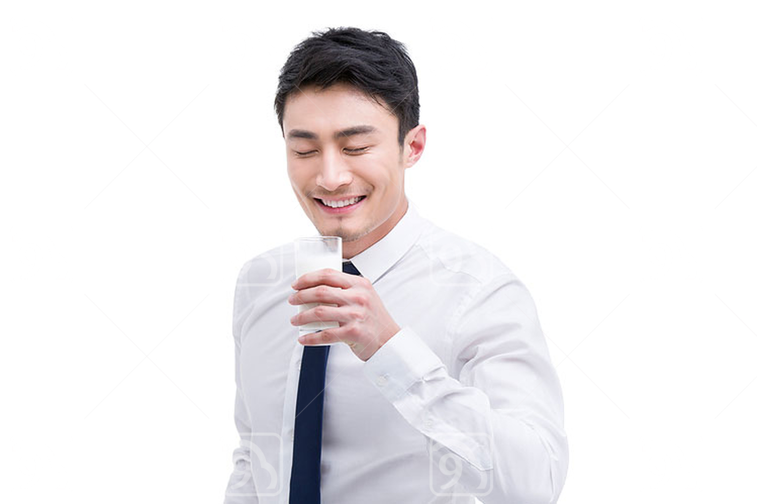 Happy young Chinese businessman with milk