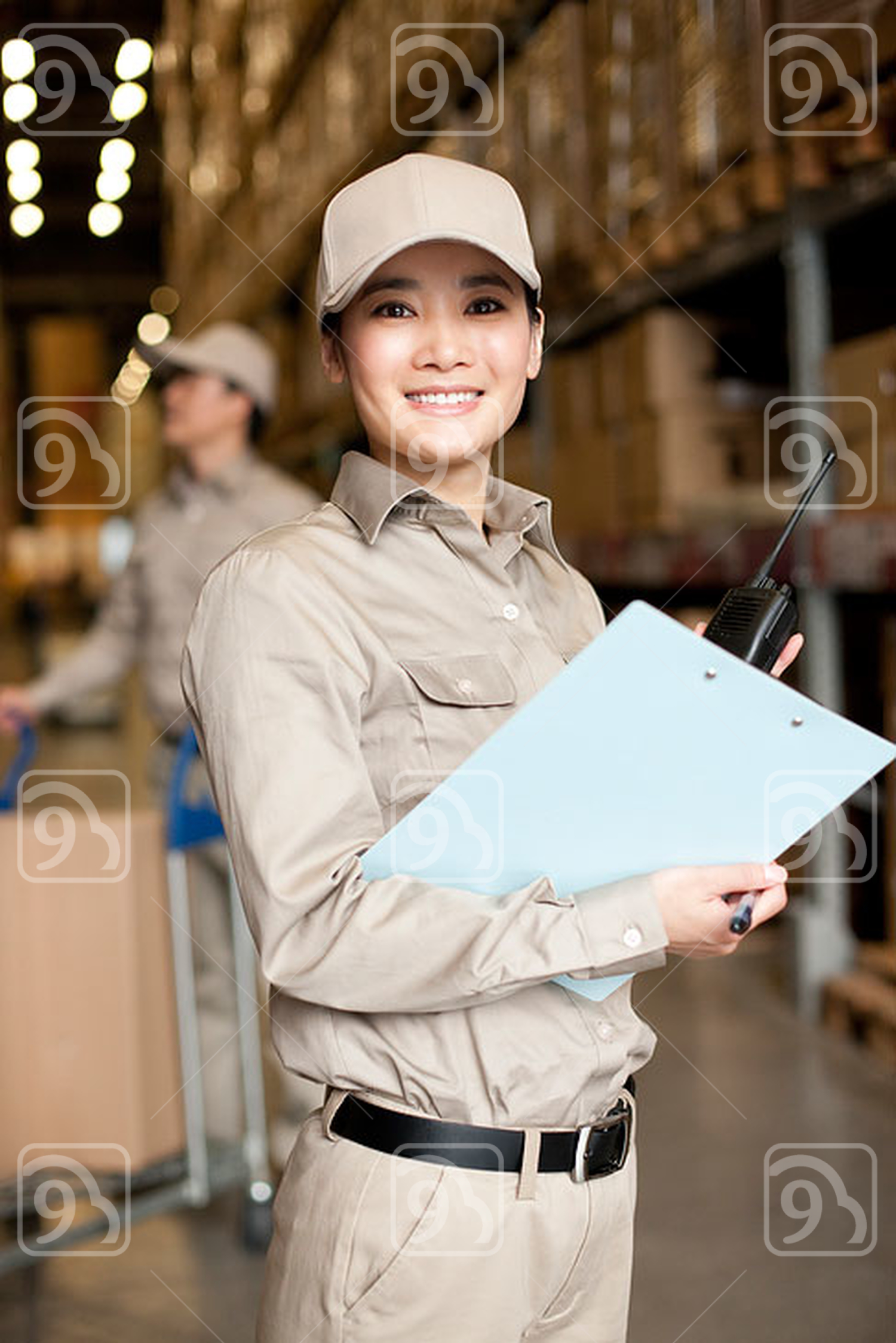 Female Chinese workers with walkie-talkie