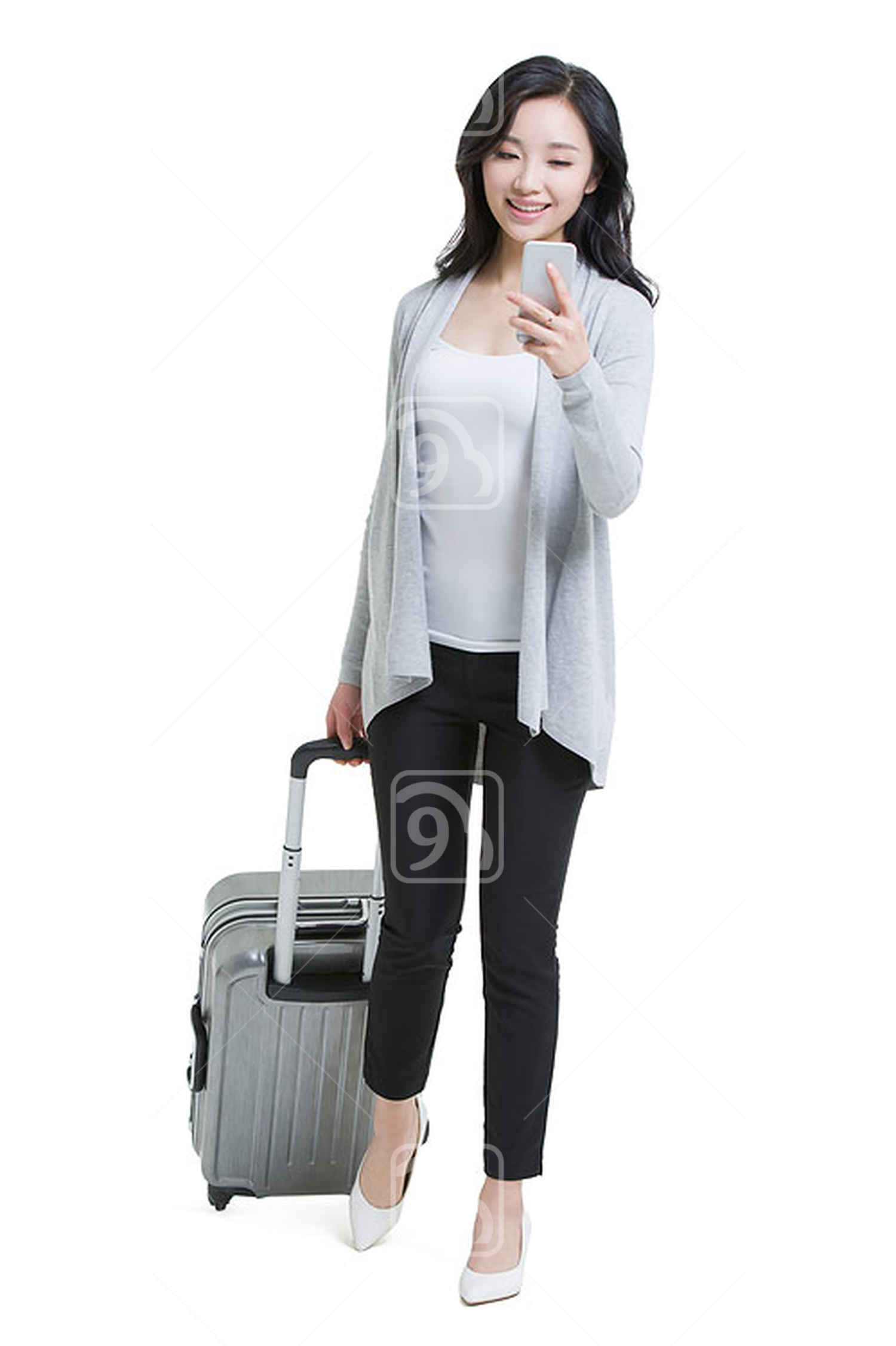 Young Chinese woman with luggage and smart phone