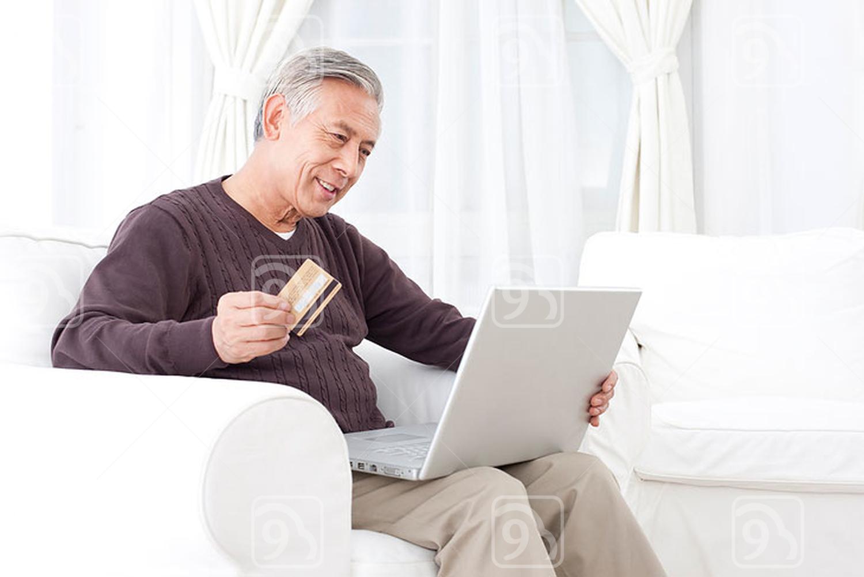 Senior Chinese man online shopping