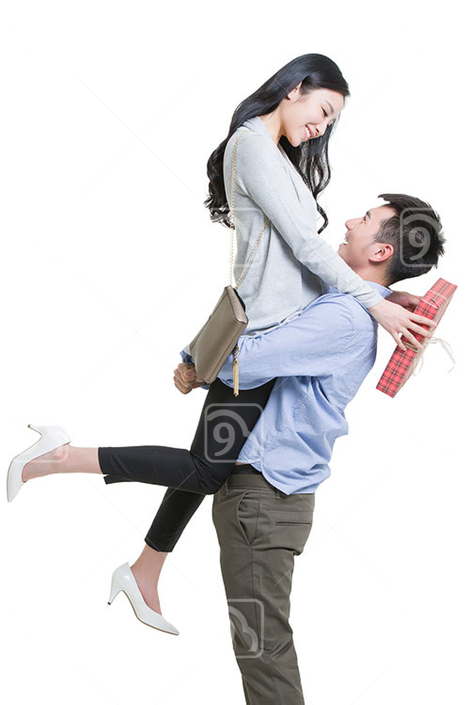 Young Chinese man giving gift to girlfriend