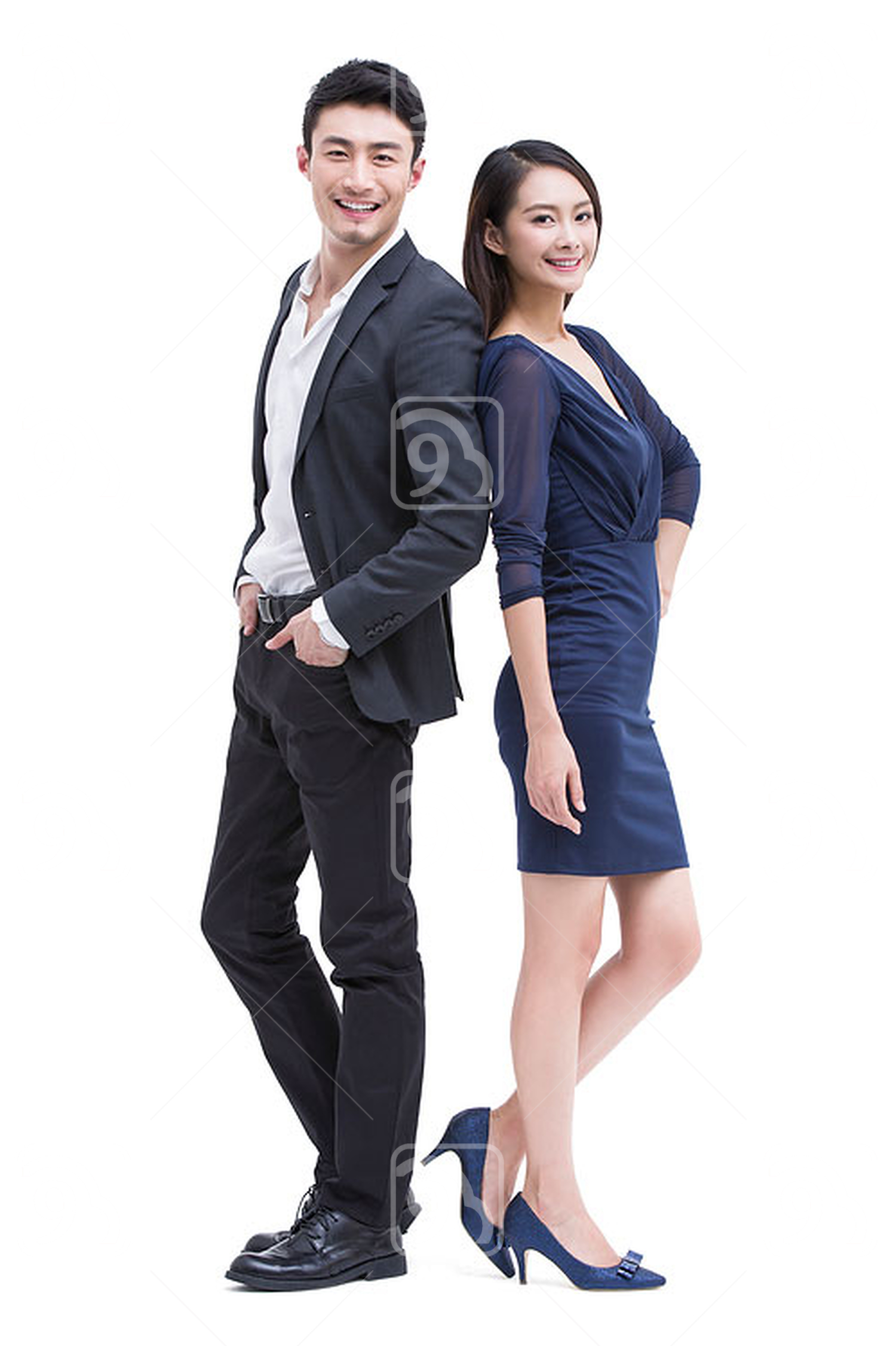 Young Chinese couple standing back to back