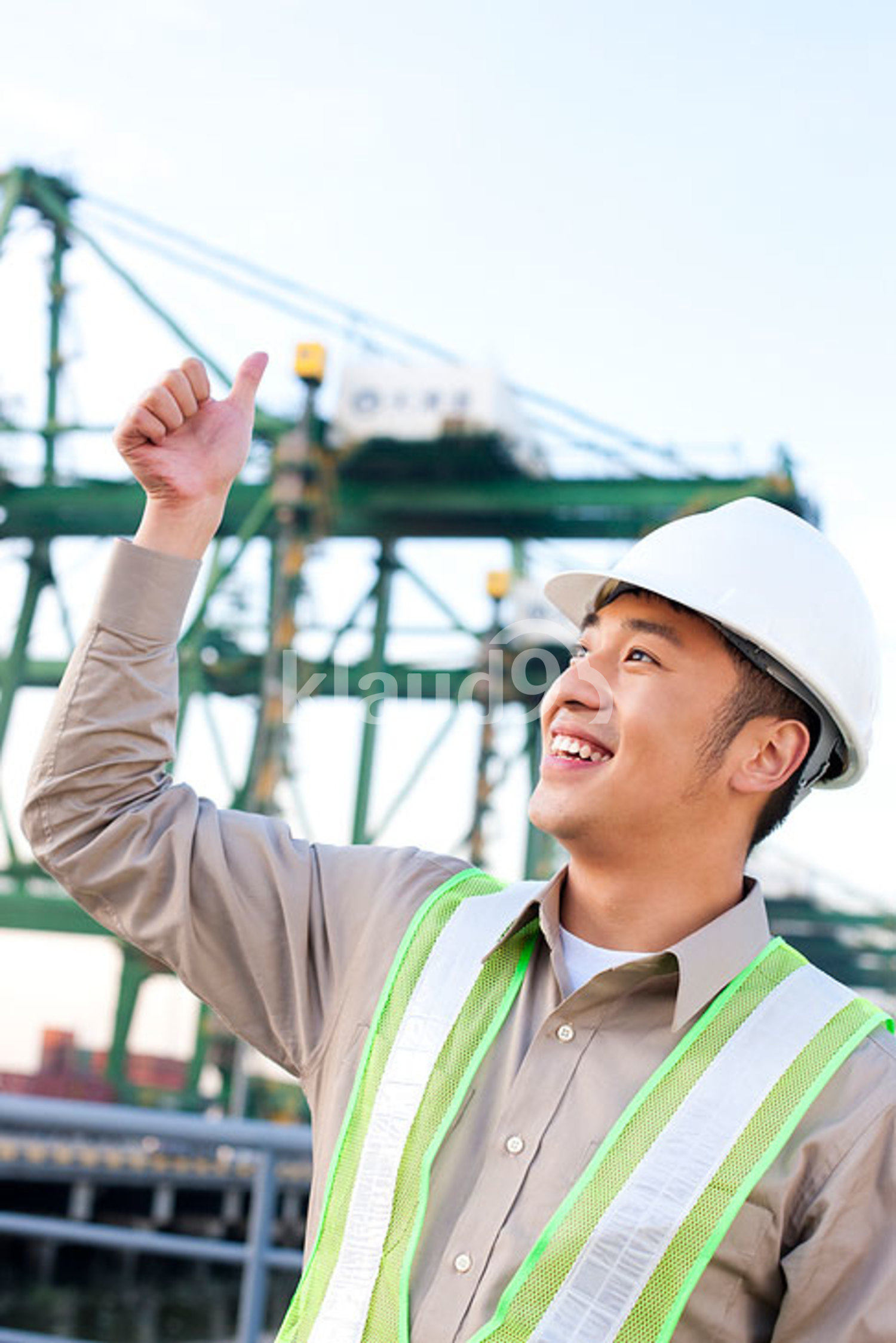 Chinese shipping industry worker giving the thumbs-up signal