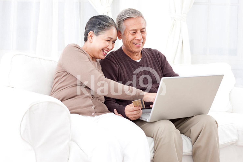 Senior Chinese couple online shopping