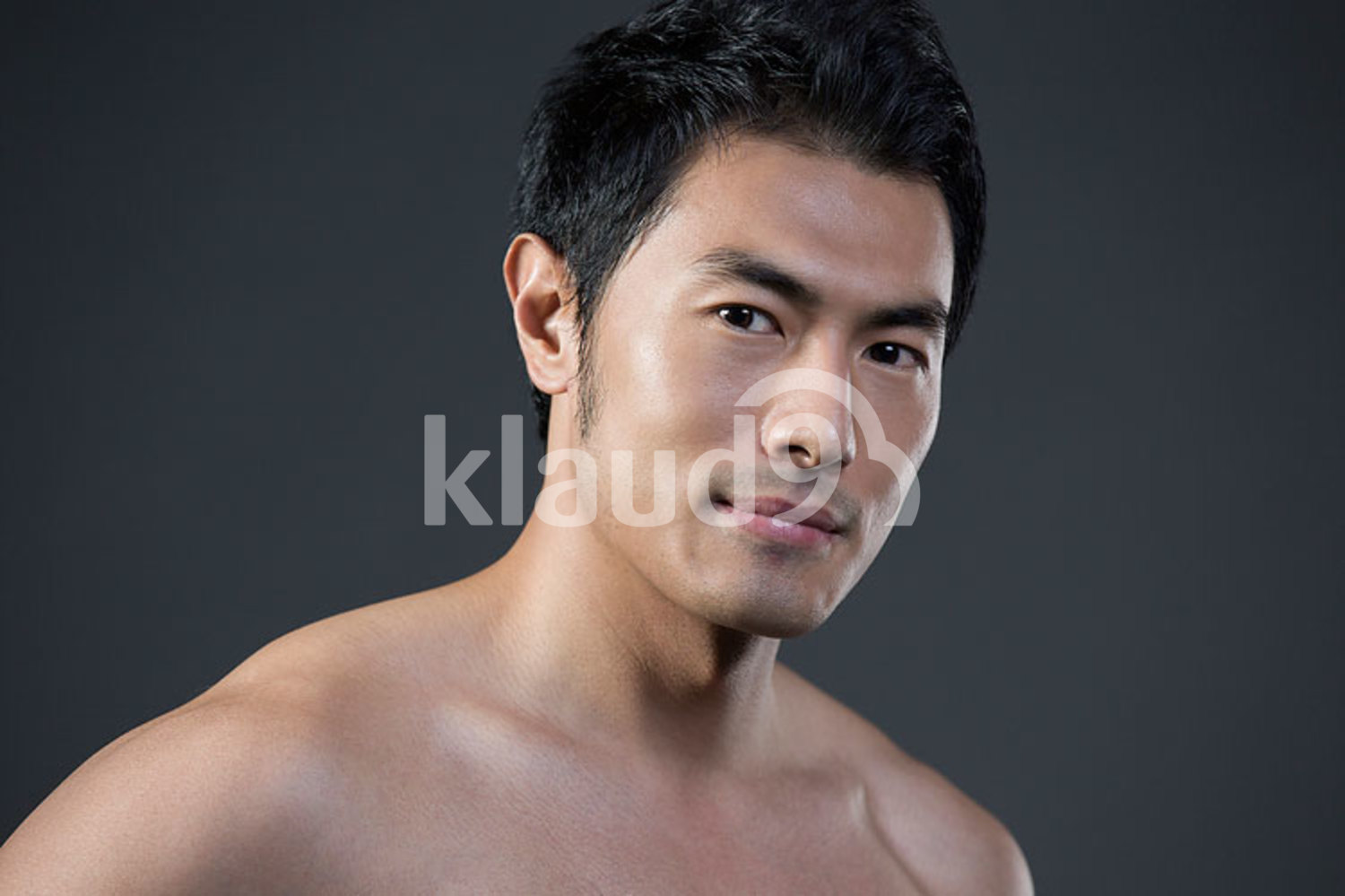 Portrait of young Chinese man with fresh skin