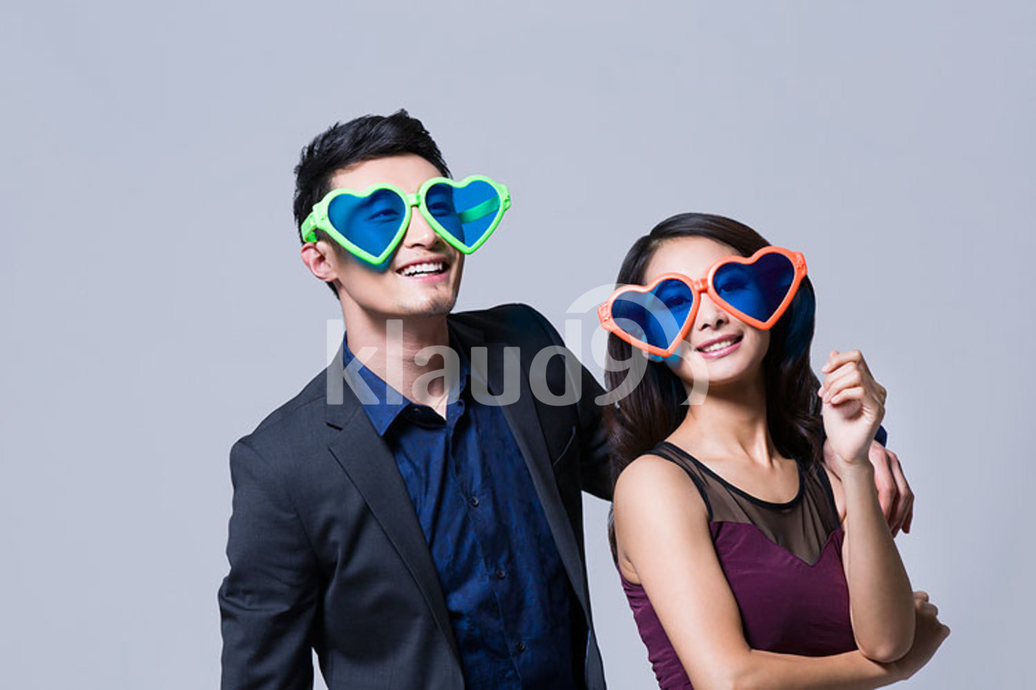 Happy young Chinese couple with big sunglasses