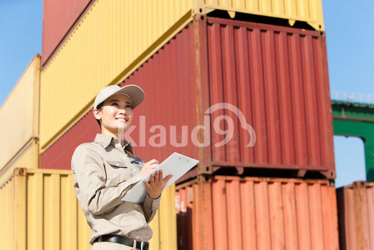 Chinese shipping industry worker with a clipboard