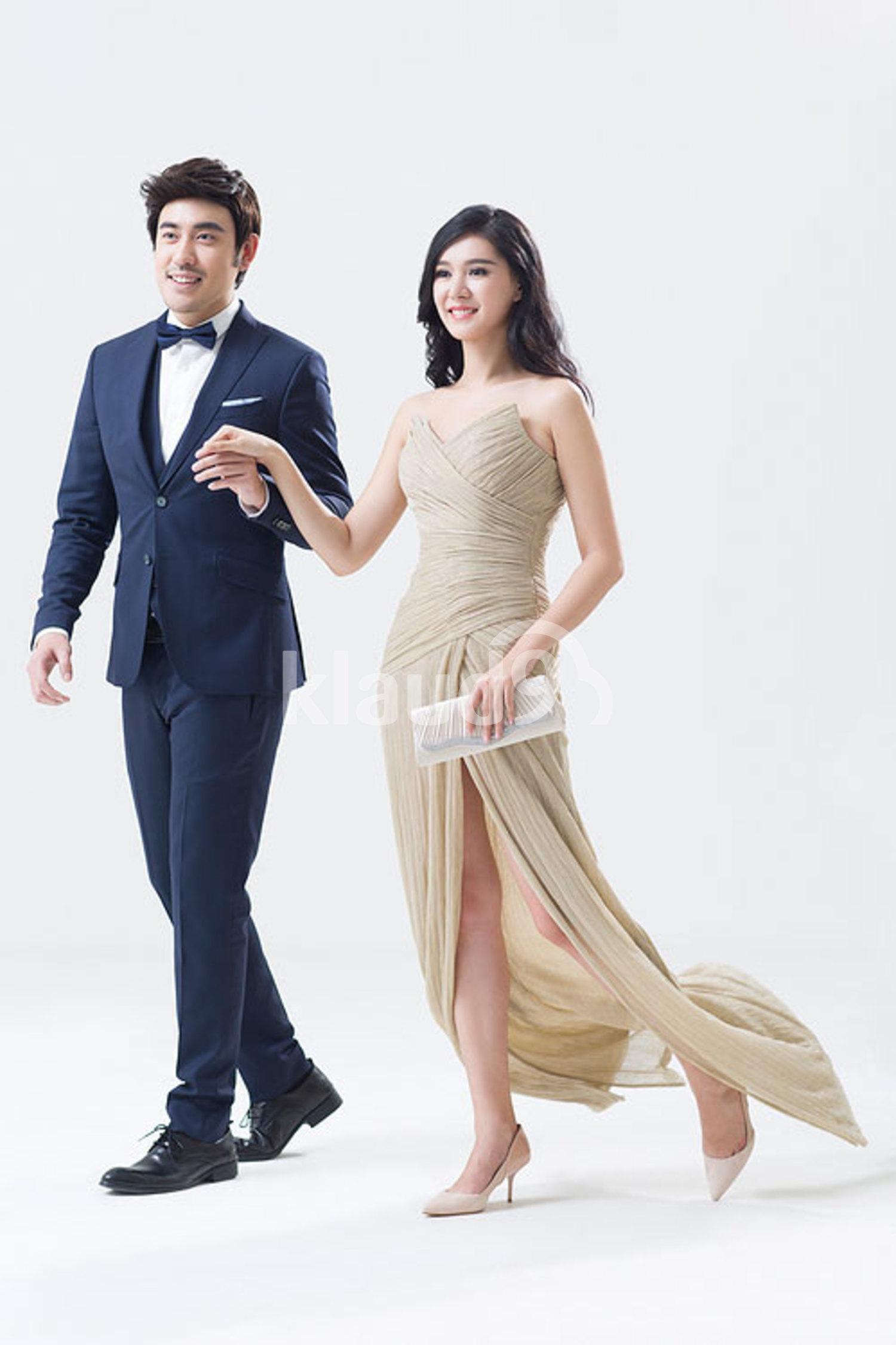 Elegant young Chinese couple walking