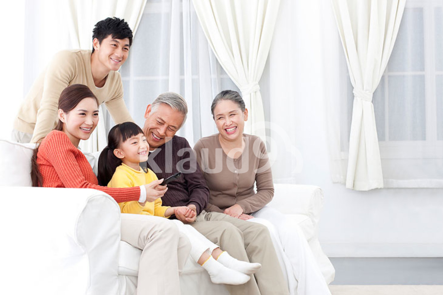 Chinese family watching TV together