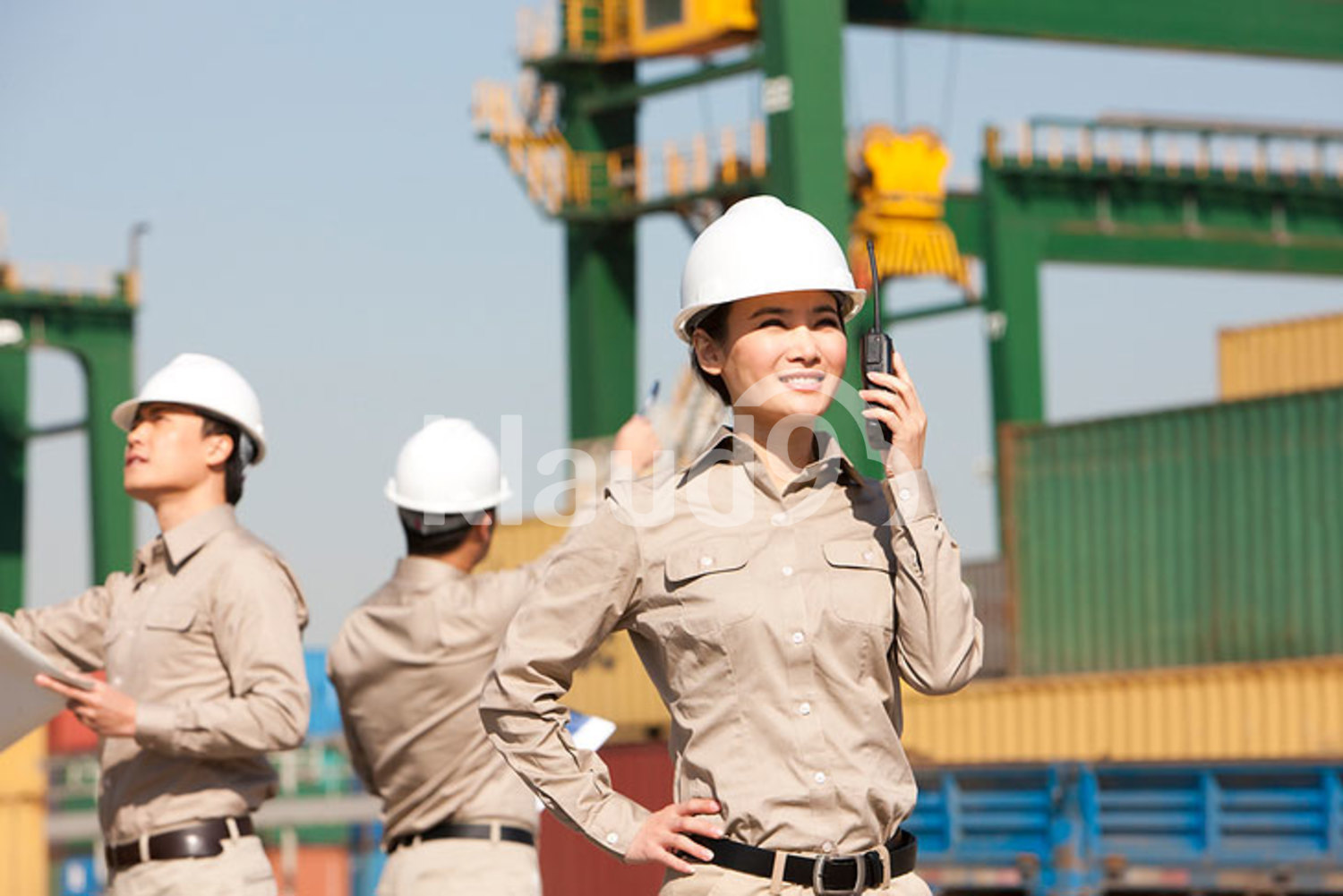 Female Chinese shipping worker with walkie-talkie