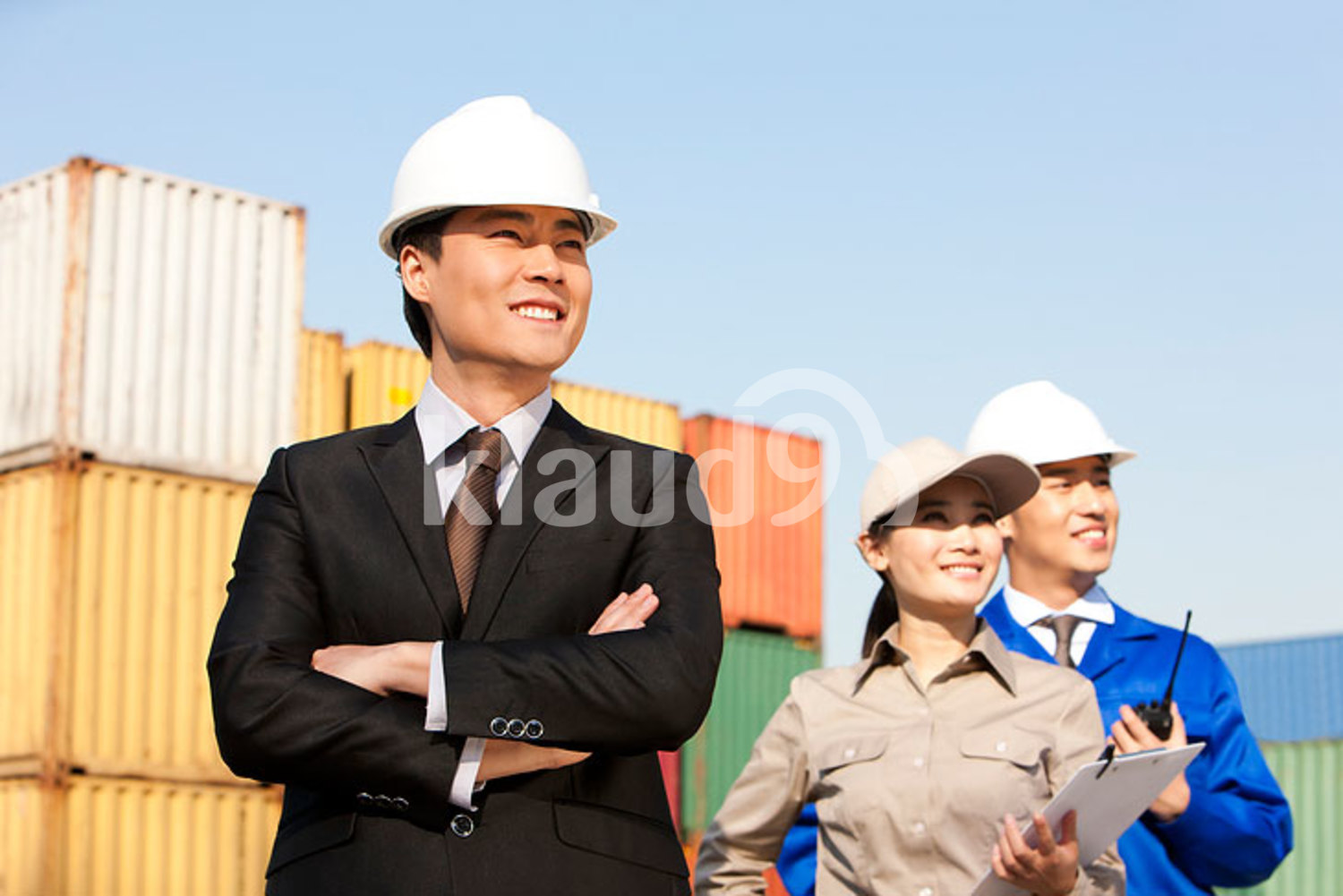 Chinese shipping industry professionals in a row