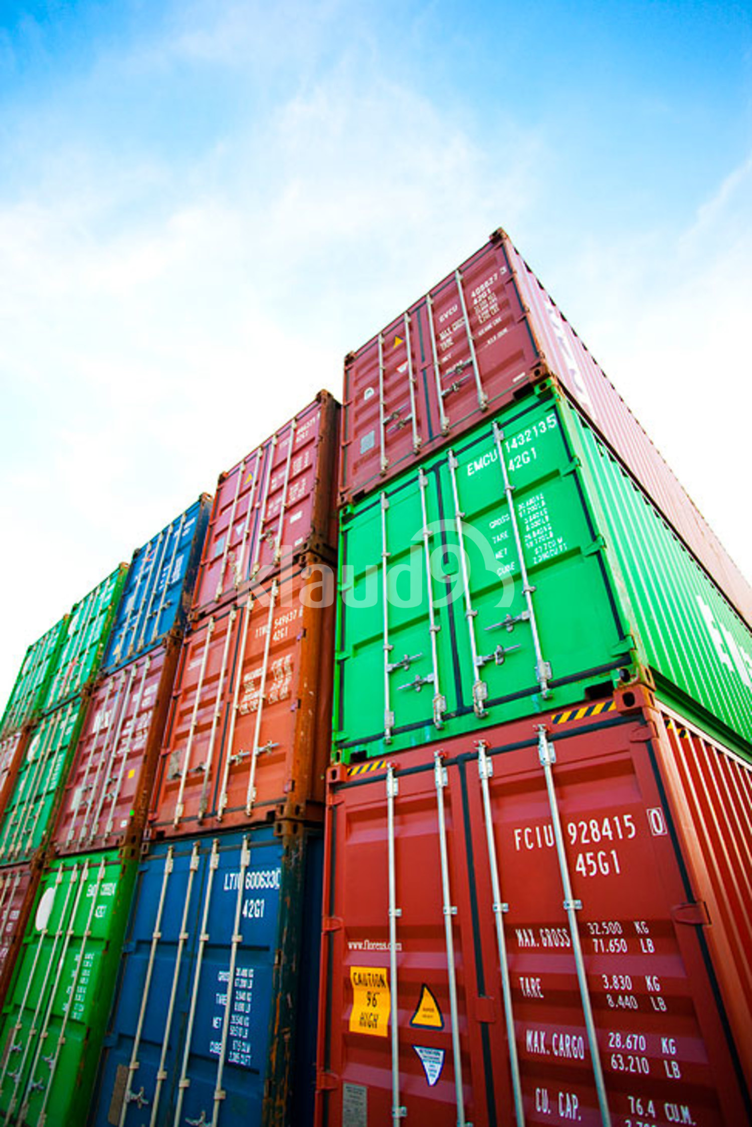 Multi-colored stack of cargo containers