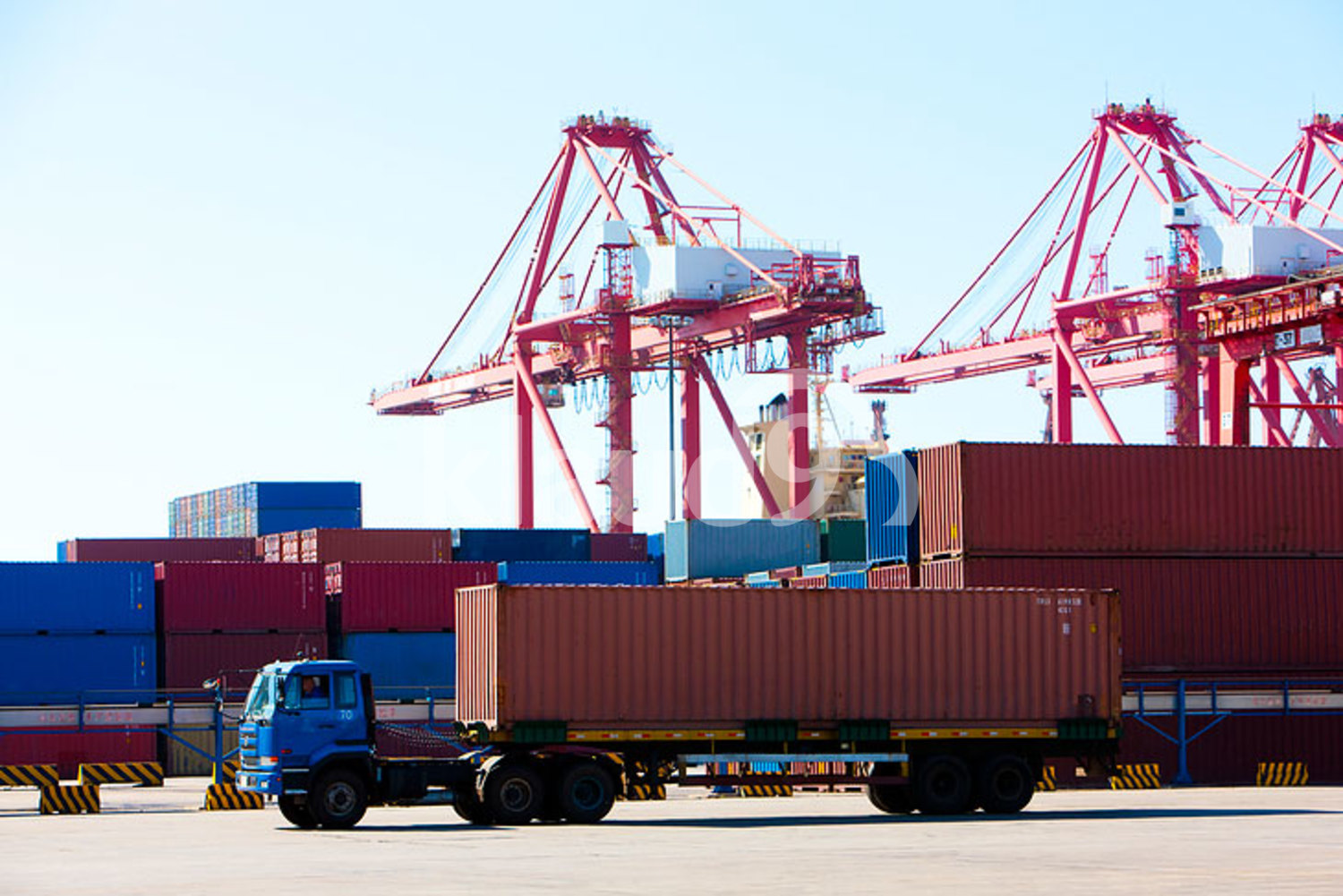 Cranes and cargo containers in shipping dock