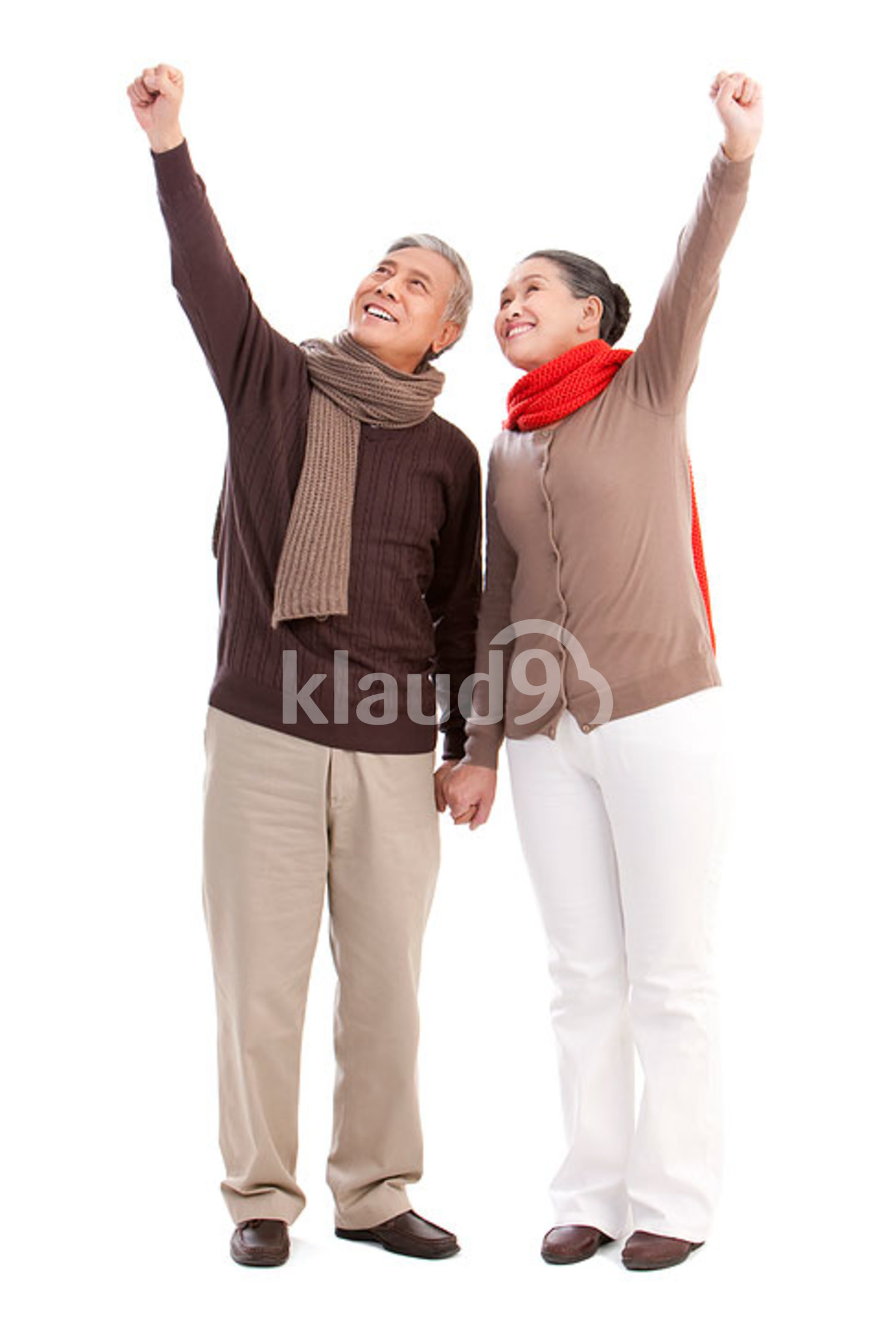 Senior Chinese couple punching the air