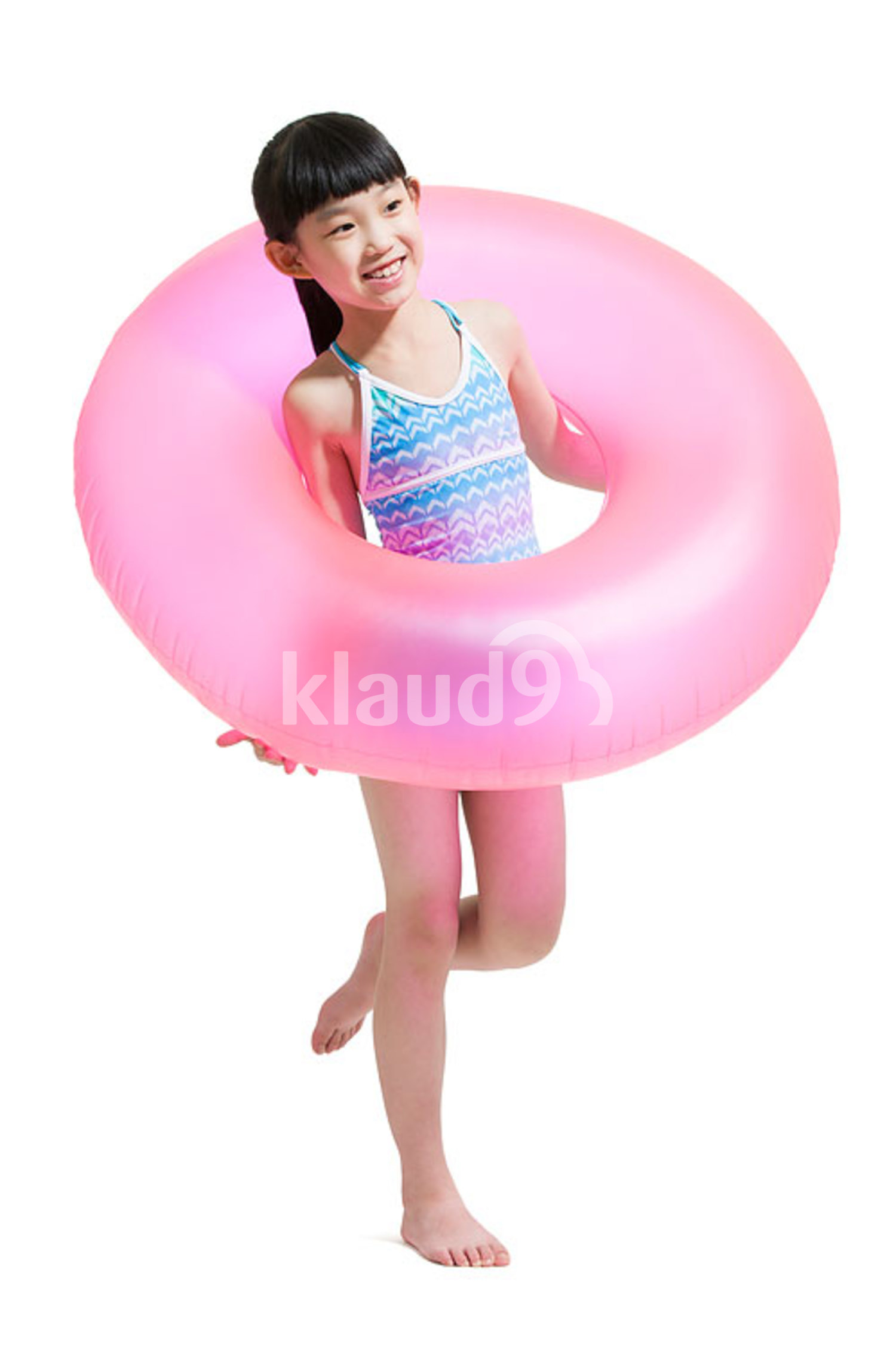 Cute Chinese girl in swimsuit with swim ring