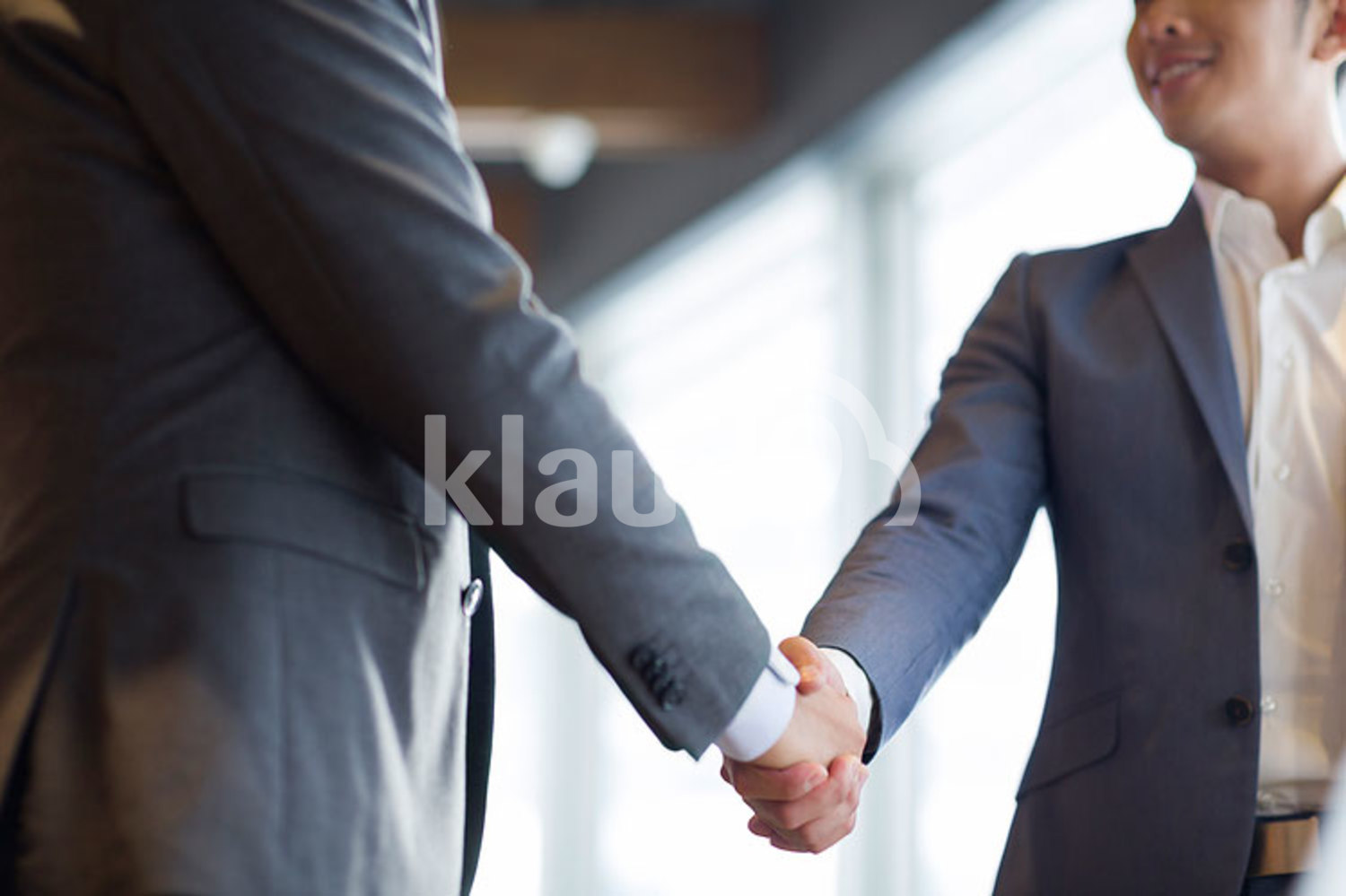 Chinese businessmen shaking hands