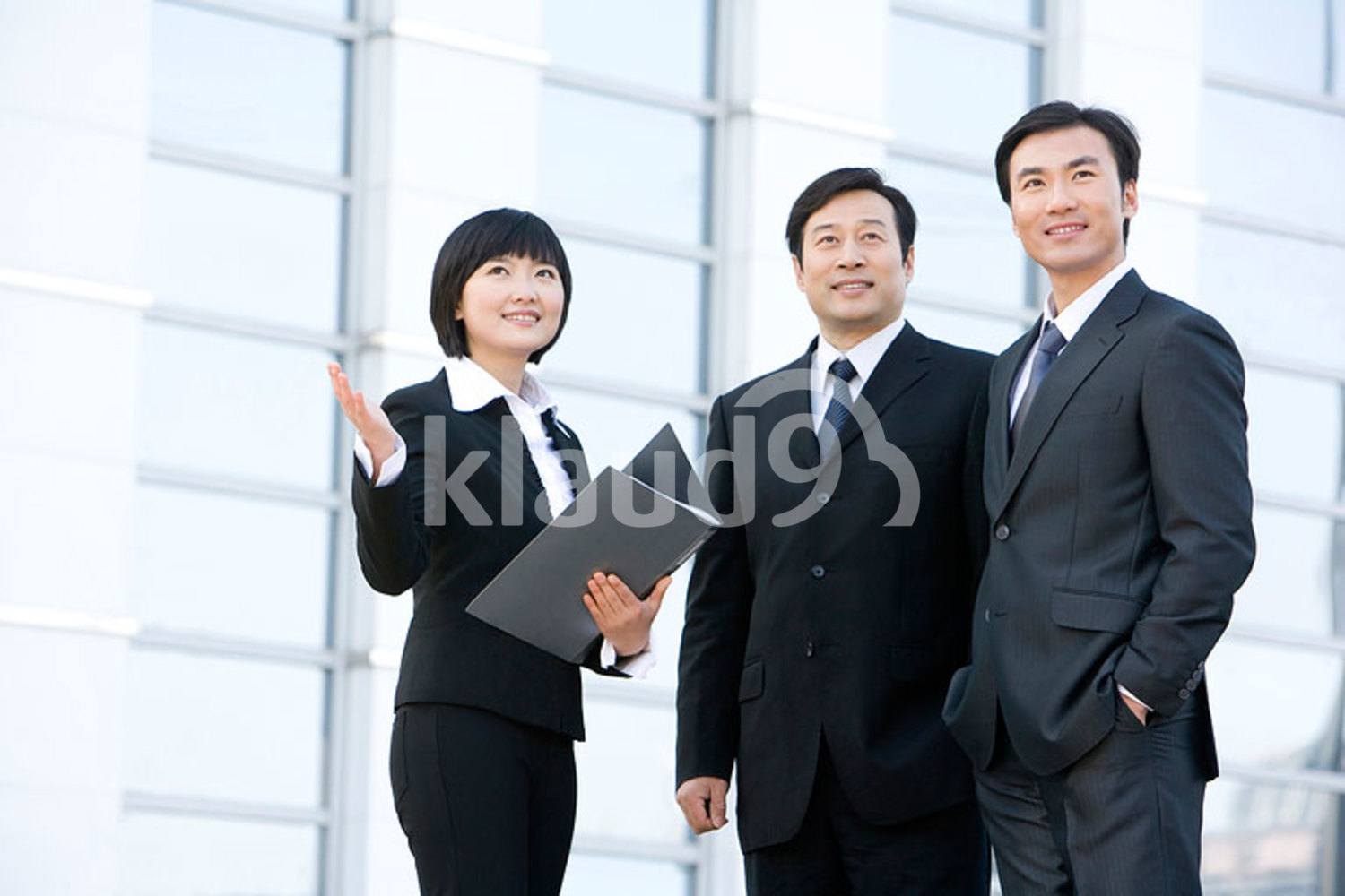 Chinese business team discussing future plans