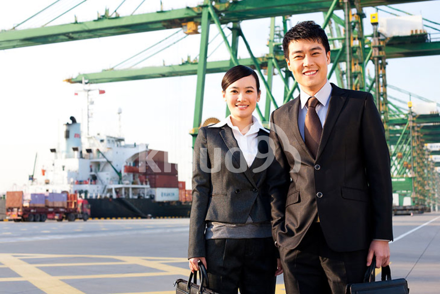 Chinese businesspeople at a shipping port