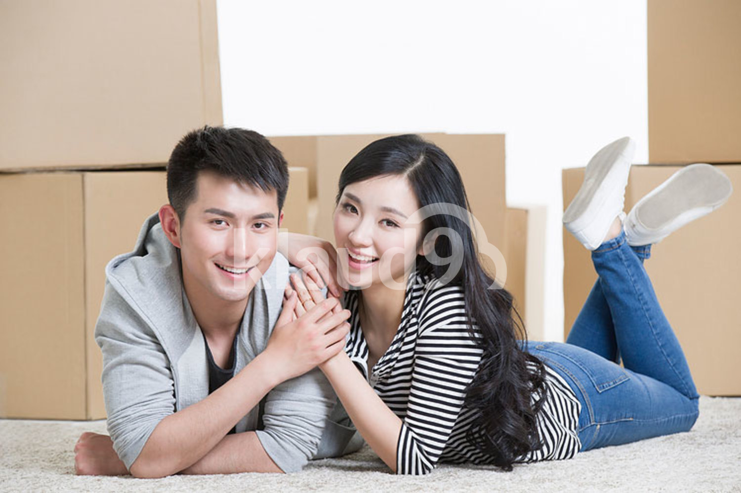 Young Chinese couple moving to a new house