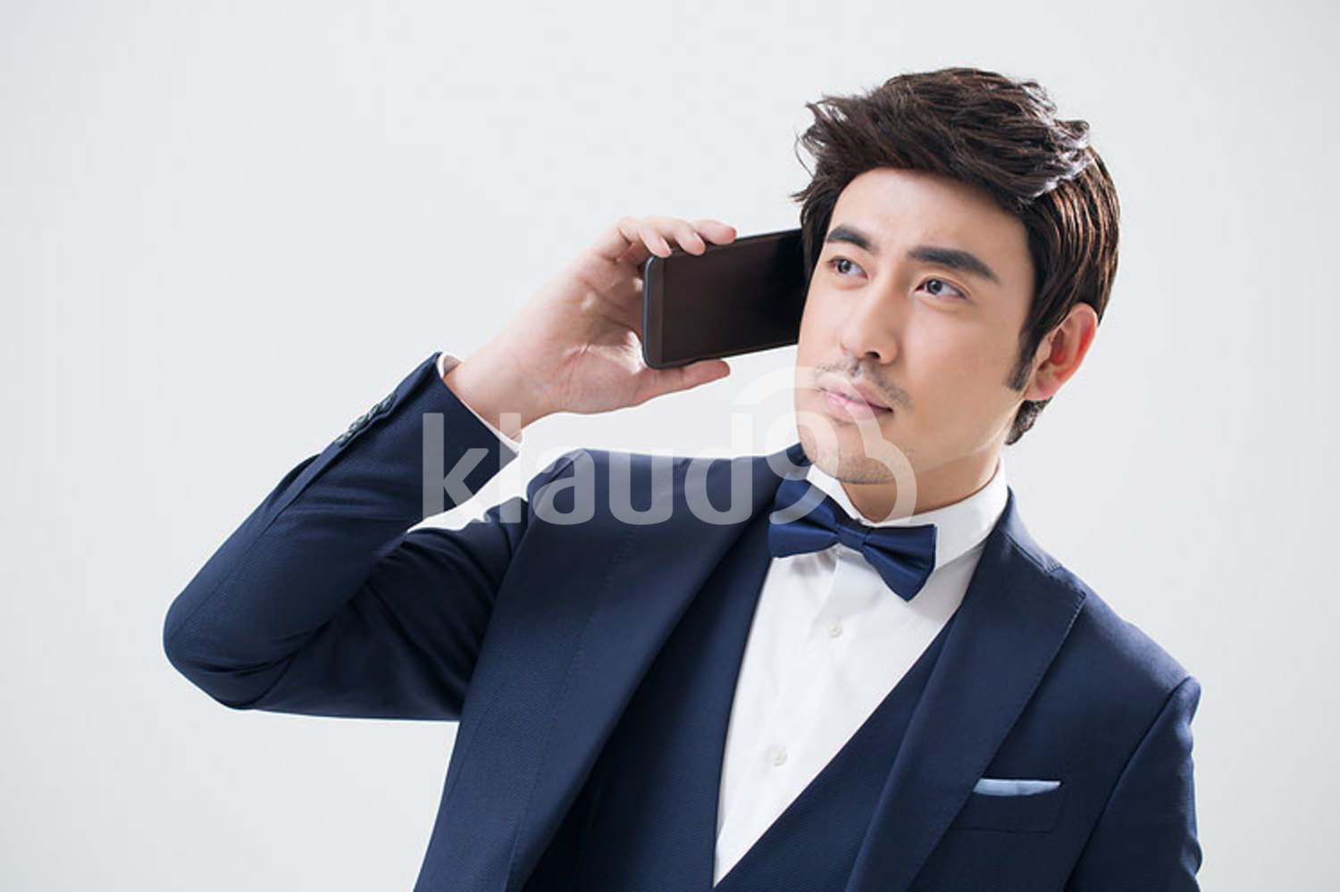 Young Chinese man talking on the phone