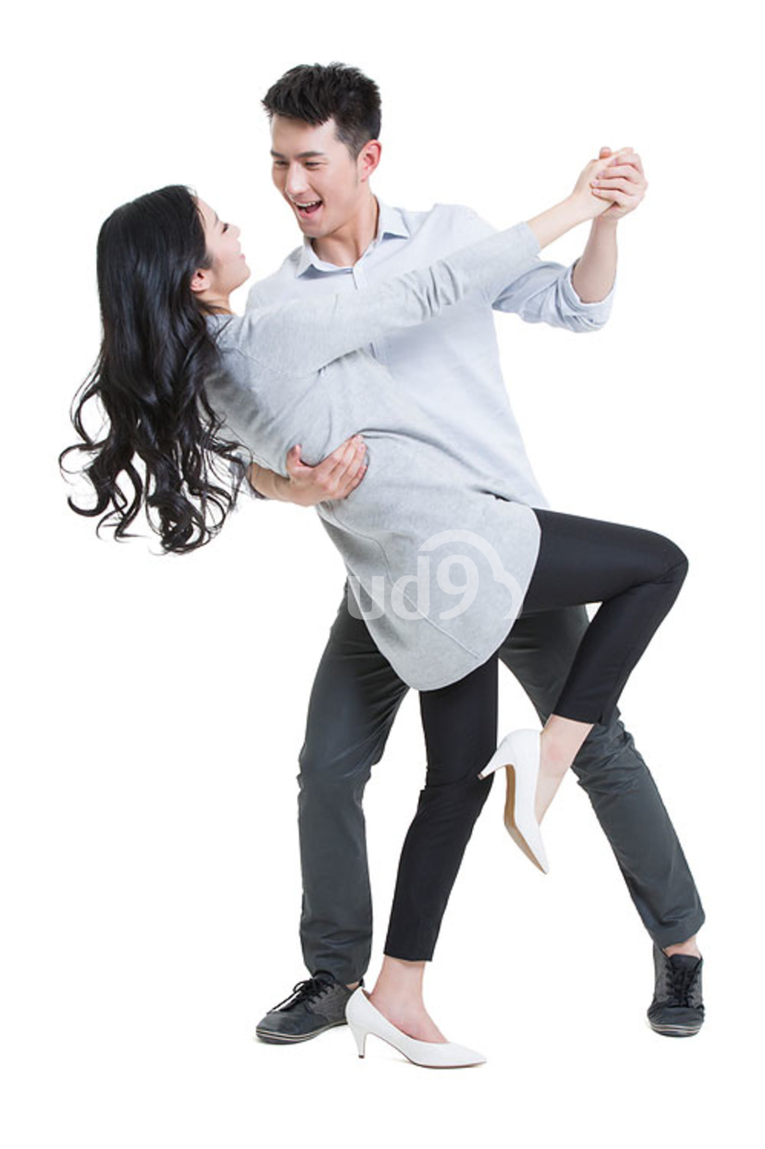 Happy young Chinese couple dancing