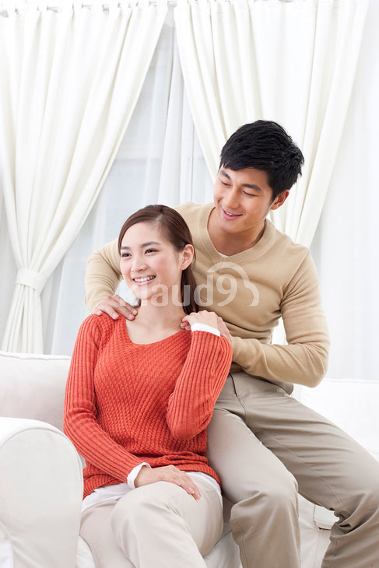 Chinese husband doing message for his wife
