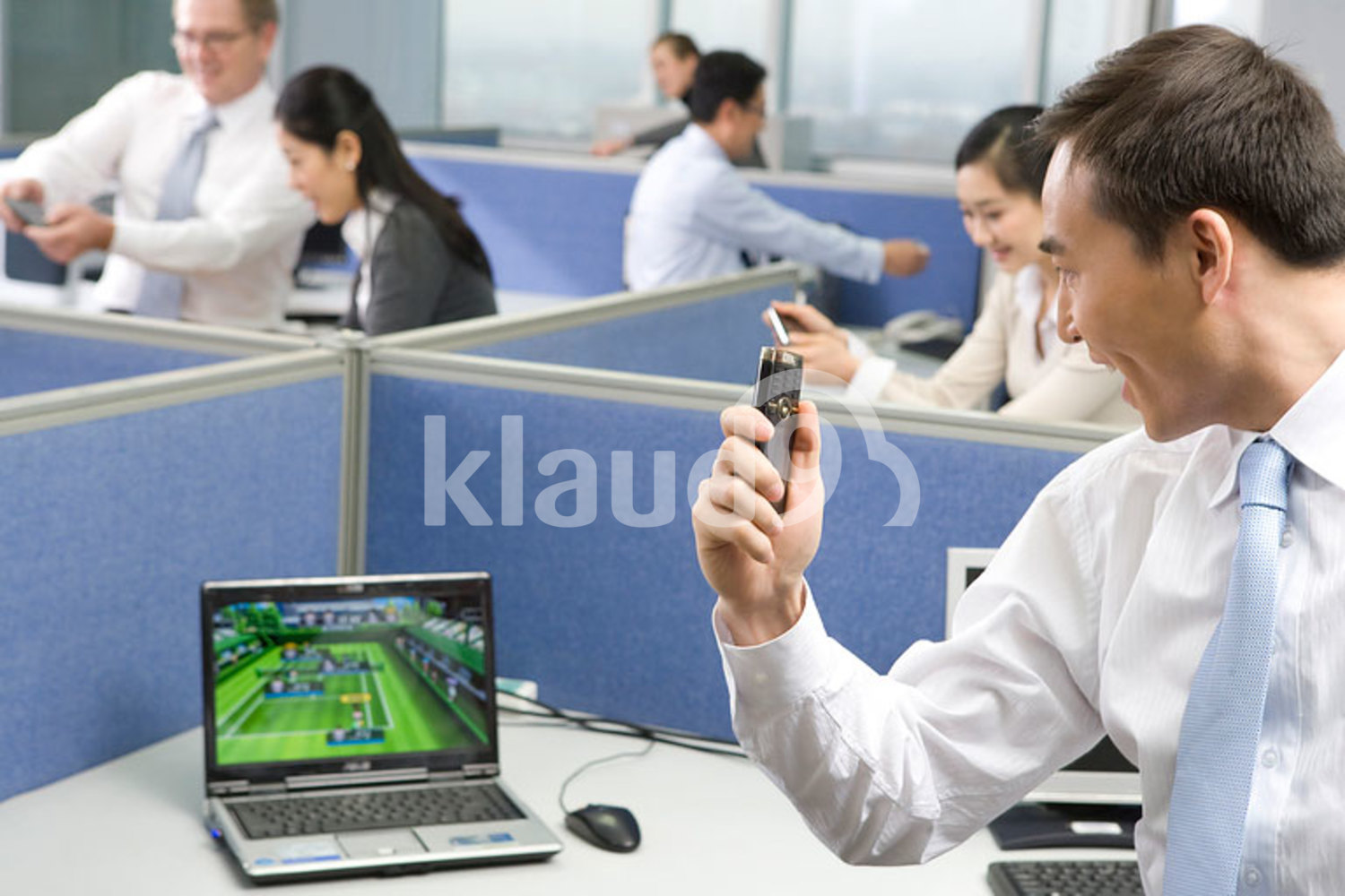 Chinese businessman having fun at the office